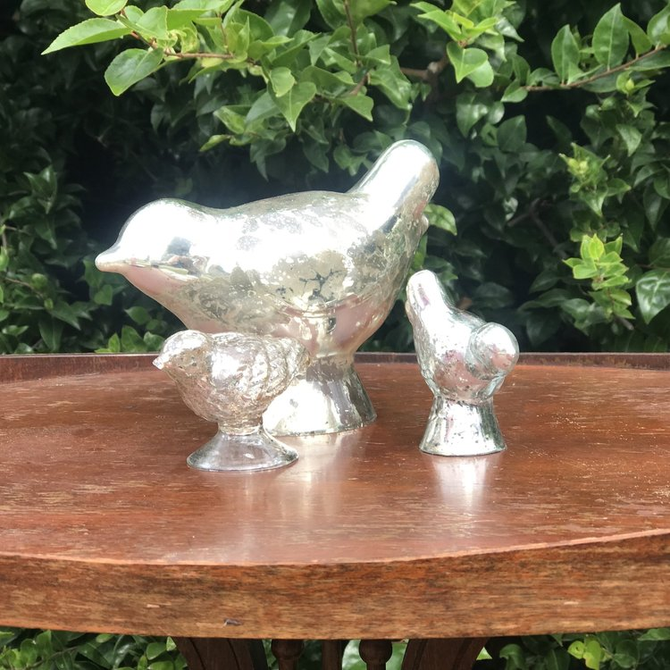 Mercury Glass Birds   Assorted sizes of Mercury glass birds. Looks great as an accent piece.