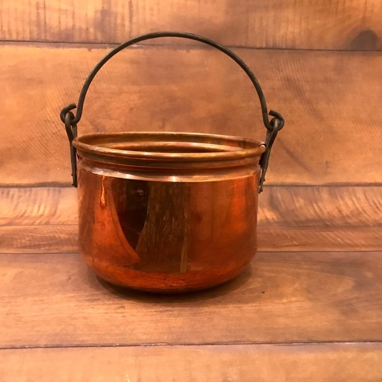 Copper pot with a handle for hanging.