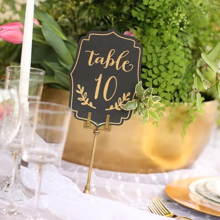 Brass table number holder. Wedding rentals.