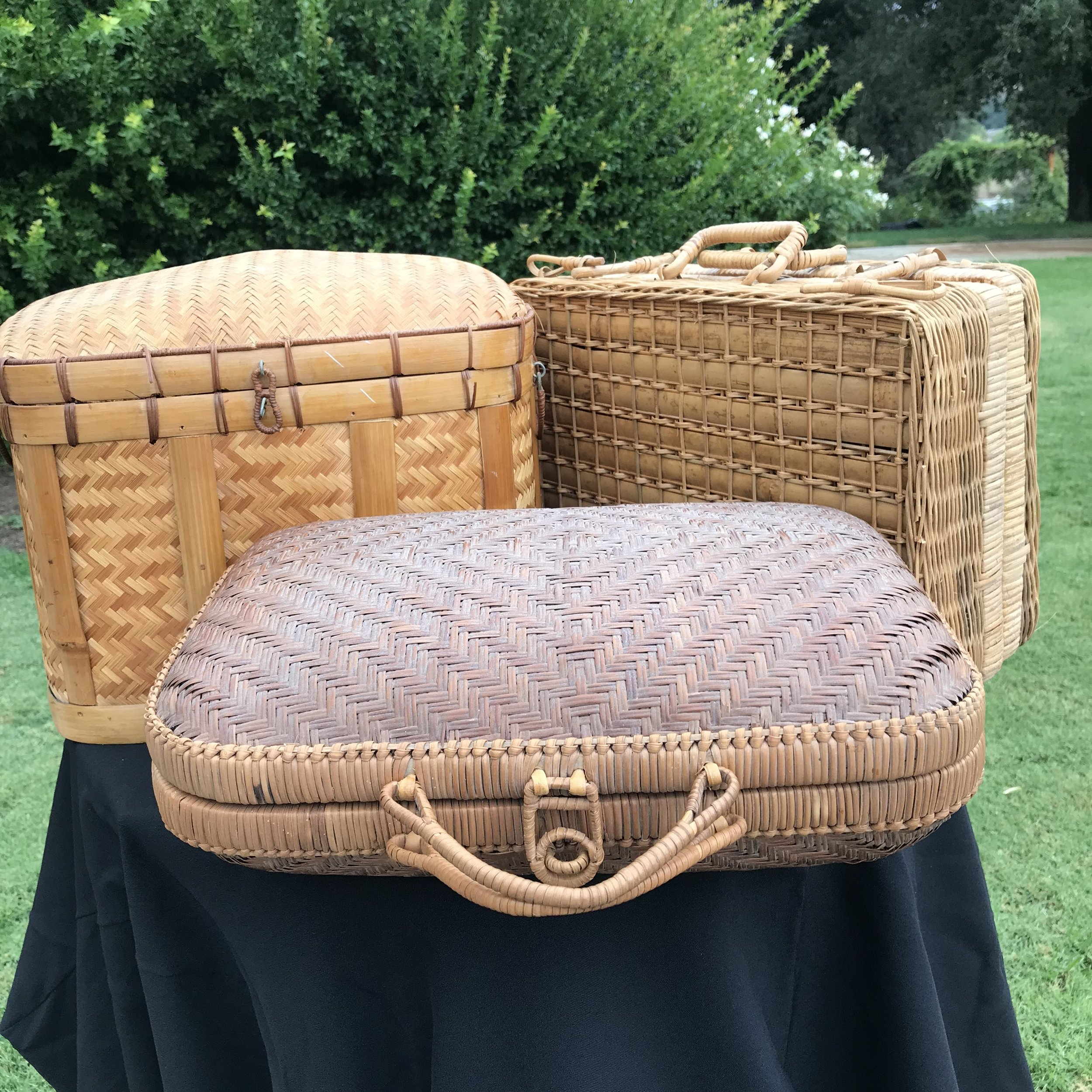 Wicker Baskets   Assorted wicker suitcases. Perfect for cards at your wedding, or great for accent display.