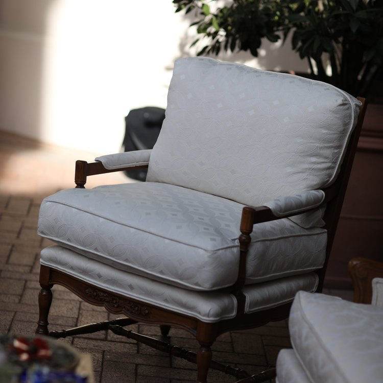 """Natalie  Cream, loose back, Bergere chair with floral carving in the wood. Matching fabric with Camila and Hannah. Seat 26""""x24"""". 34"""" tall."""