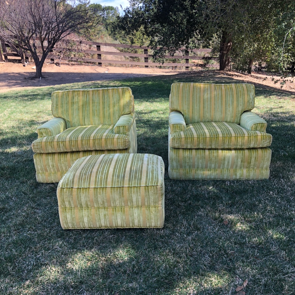 Lime green mid century modern stuffed chairs and ottoman.