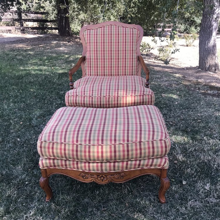 """Dolly  Burgundy, cream, and green plaid, country style chair and ottoman. Sculpted floral leaf detail in the wood. Chair 30"""" x 19"""" x 38.5"""" Ottoman 19"""" x 21"""" sculpted."""