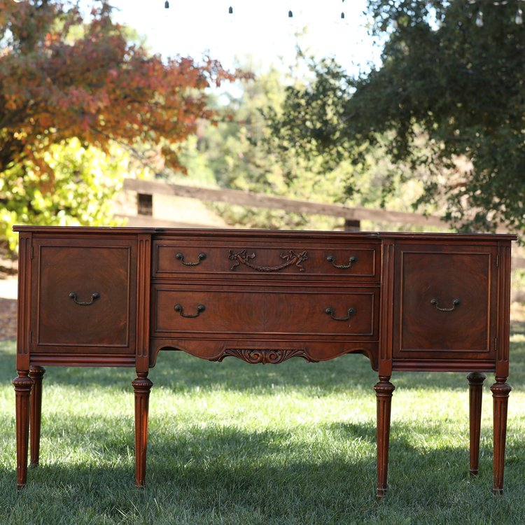 May   Vintage Mahogany buffet. Two drawers and two side cabinets. Beautiful scroll work. Perfect as a dessert bar or sign in area.