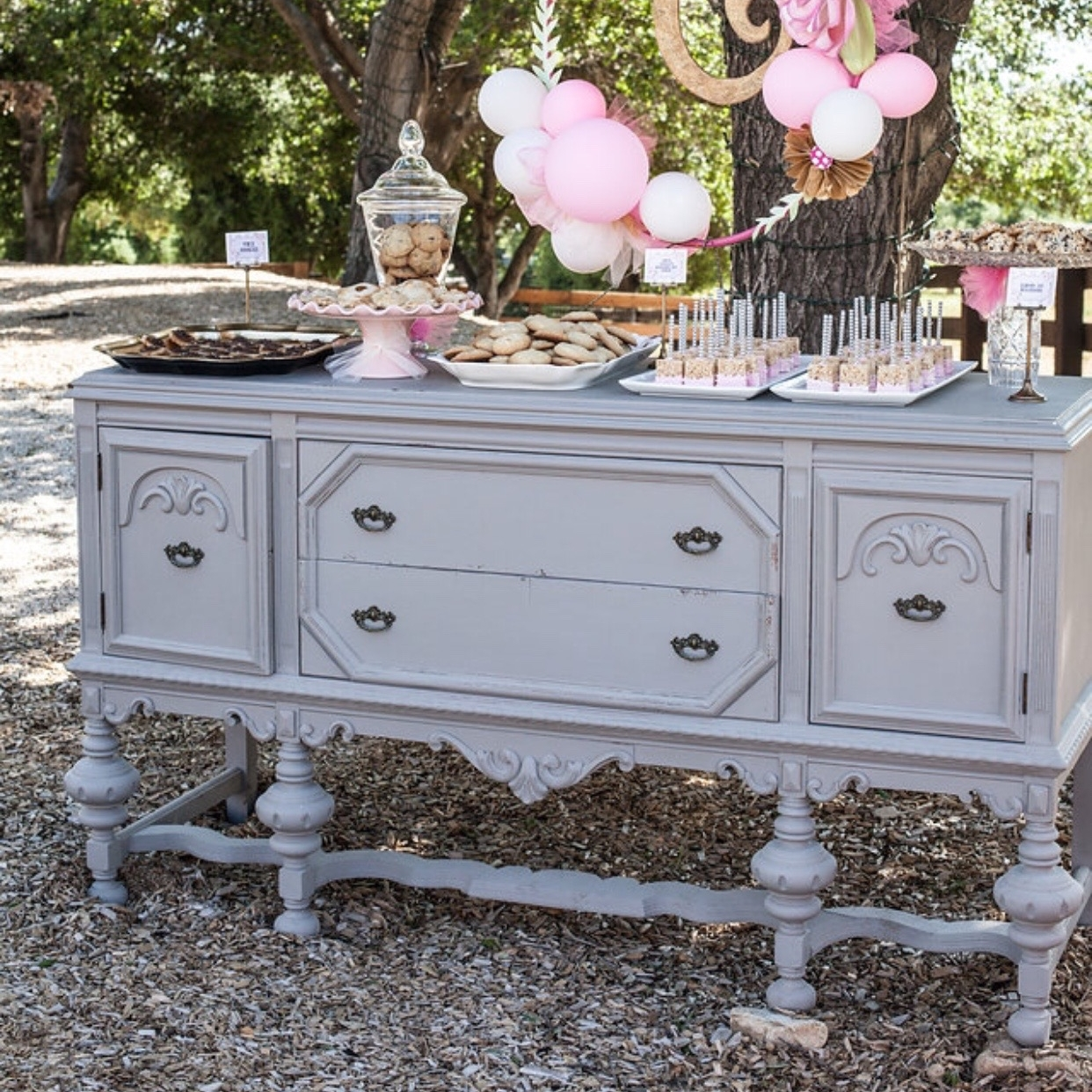 "Hattie   French Linen antique buffet with two doors and two drawers. Hot pink interior. Scalloped bottom with four ornate legs. 70"" x 22"" rectangle. 37.5"" tall."