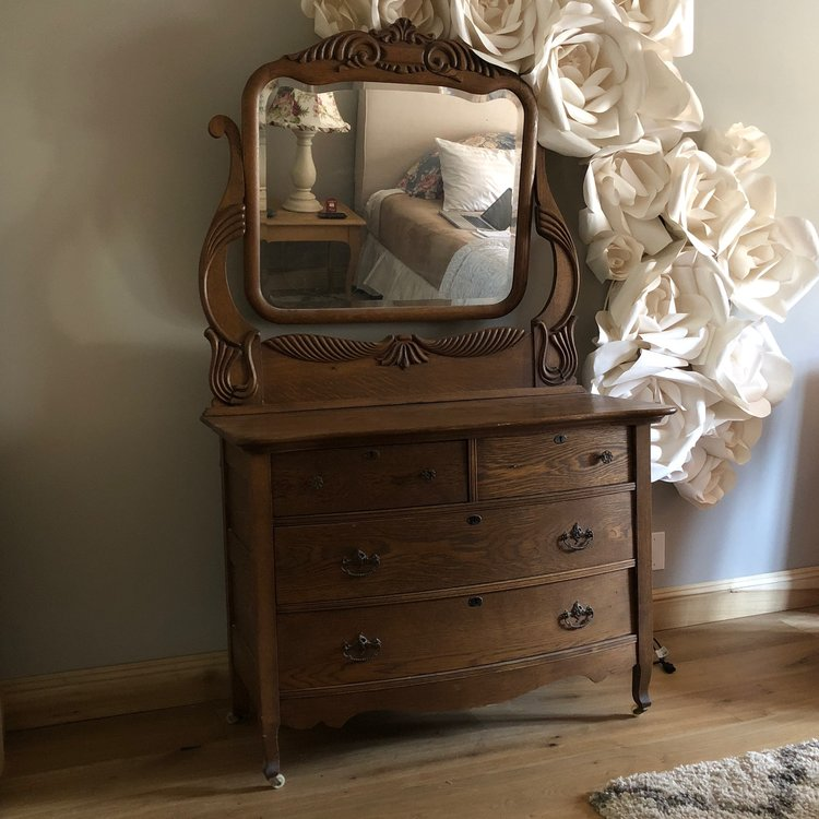 "Tucker   Antique curved front dresser with hand carved mirror. Circa 1908. 73"" tall with mirror x 20.5"" wide x 44"" long. Bottom only 32.5"" tall."