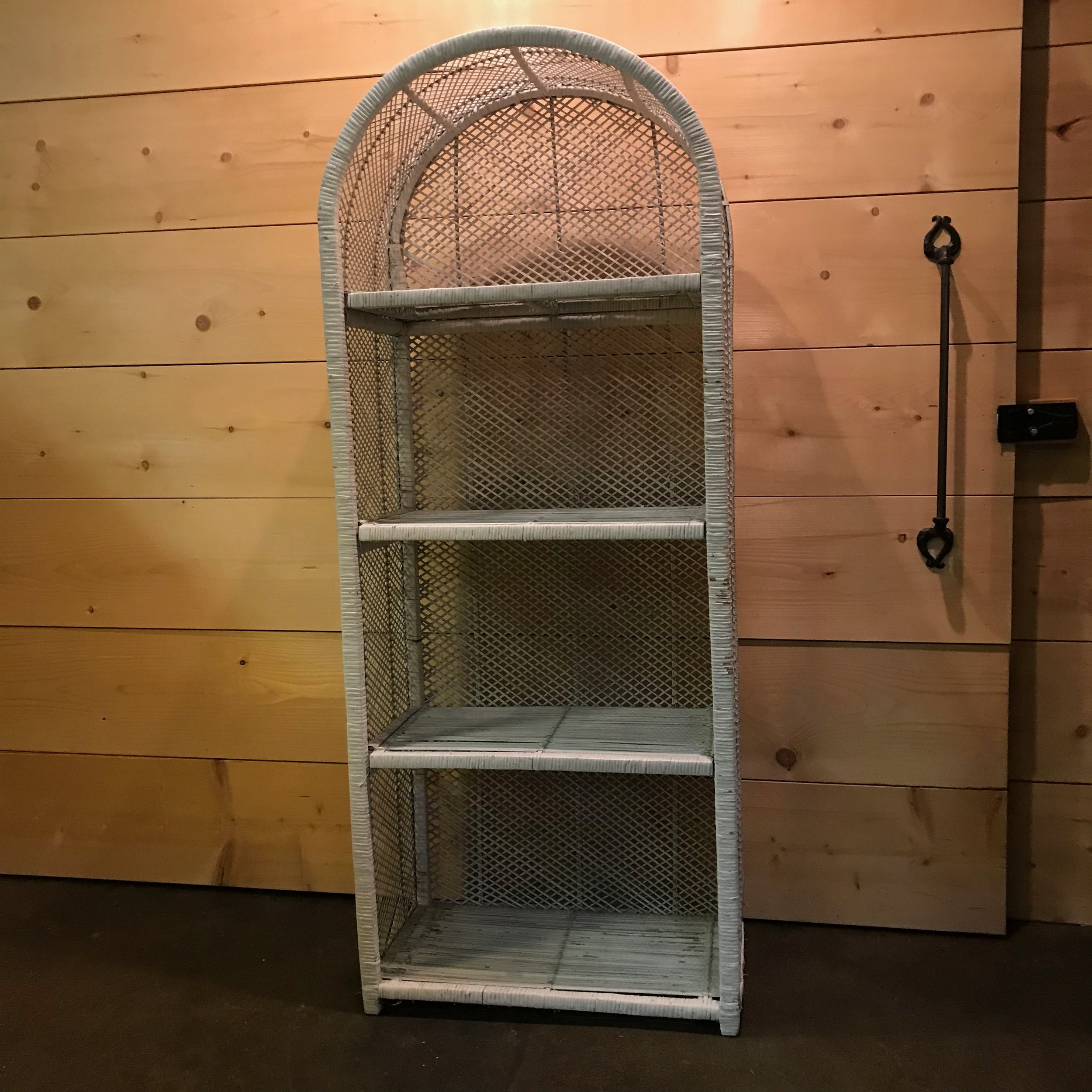 "Kenny   Boho Chic distressed white wicker etagere. Four shelves that are 14"" deep. 64.5"" tall. Great for displaying photos, favors, appetizers, desserts."
