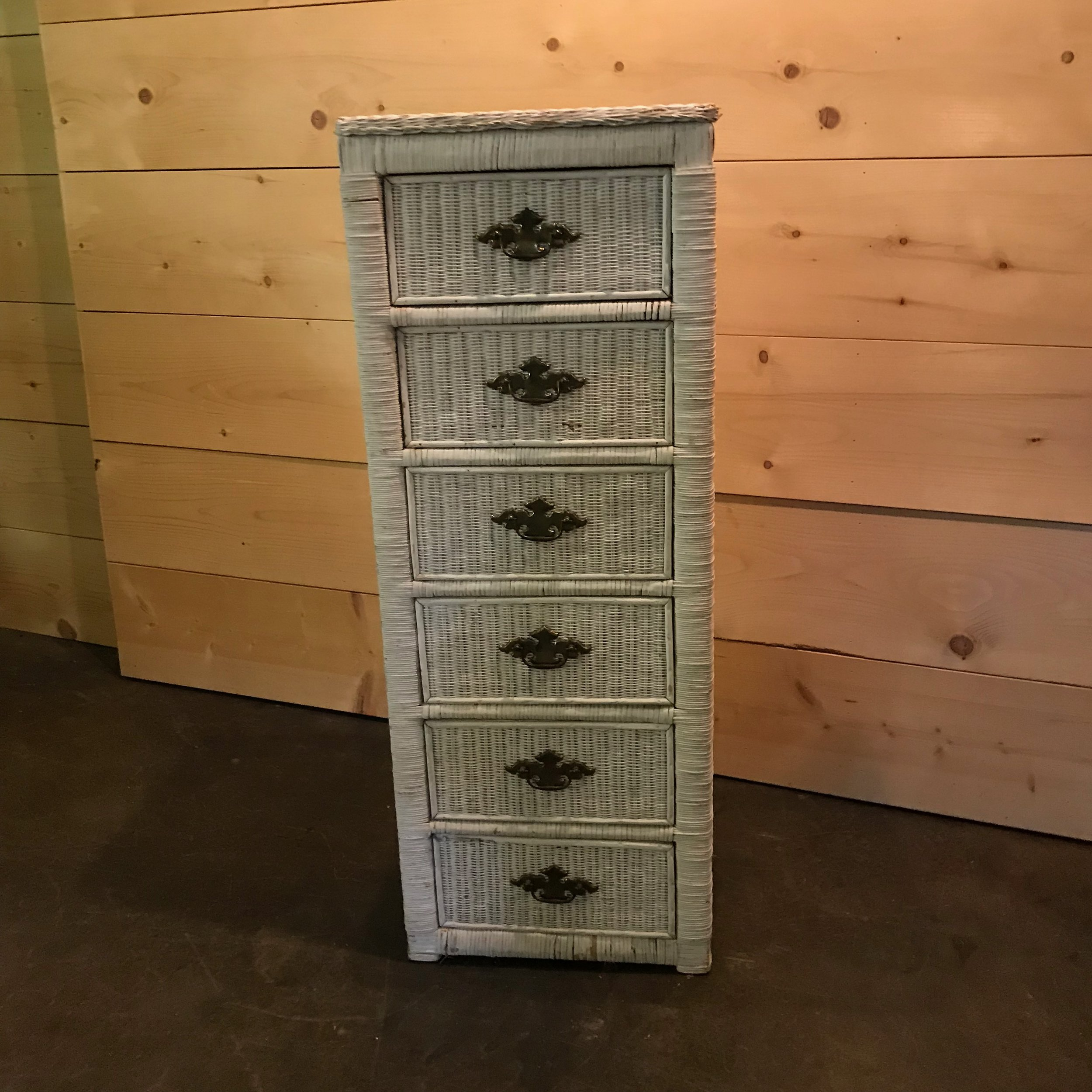 "Eugene   Narrow white wicker high boy dresser. Six drawers that open. 49"" tall x 18.5"" wide x 13"" deep. Use you imagination with this darling Boho piece."