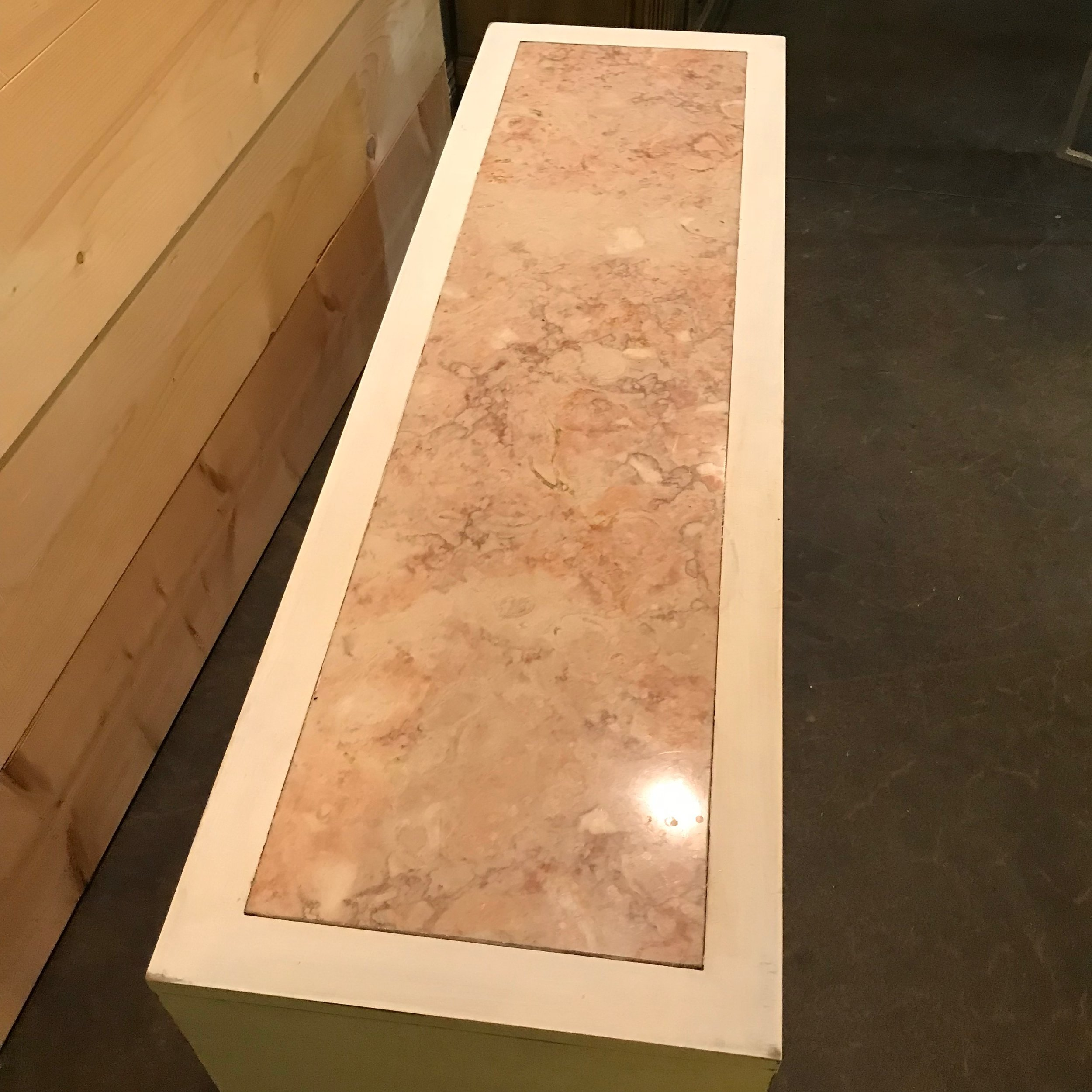 Beautiful tan swirl marble top on a Mid-Century Modern side board.