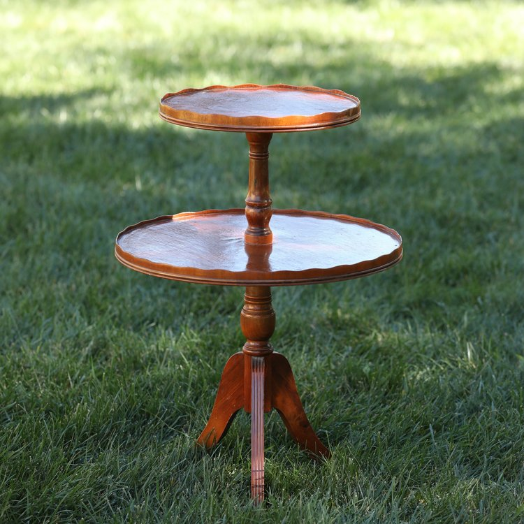 "Lizette   Wooden, two tiered, circa 1940 piecrust table with metal feet and a scalloped edge. 13""upper round, 19"" lower round by 27.5"" high"