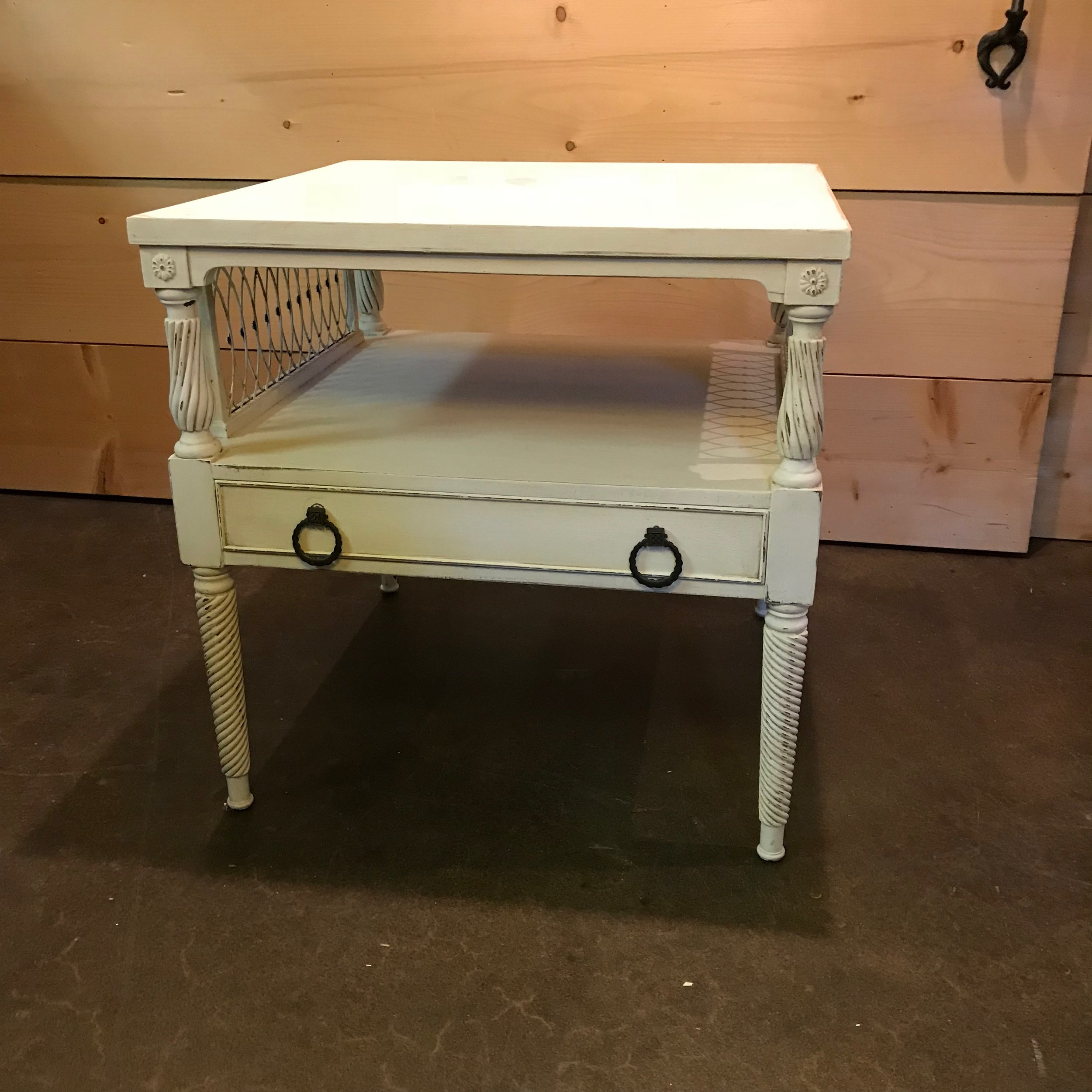 """Siobhan   Wooden, two tiered, round leather top insert, one drawer, decorative metal sides, Chalk painted white, distressed, and antiqued. 25"""" square by 25"""" high."""