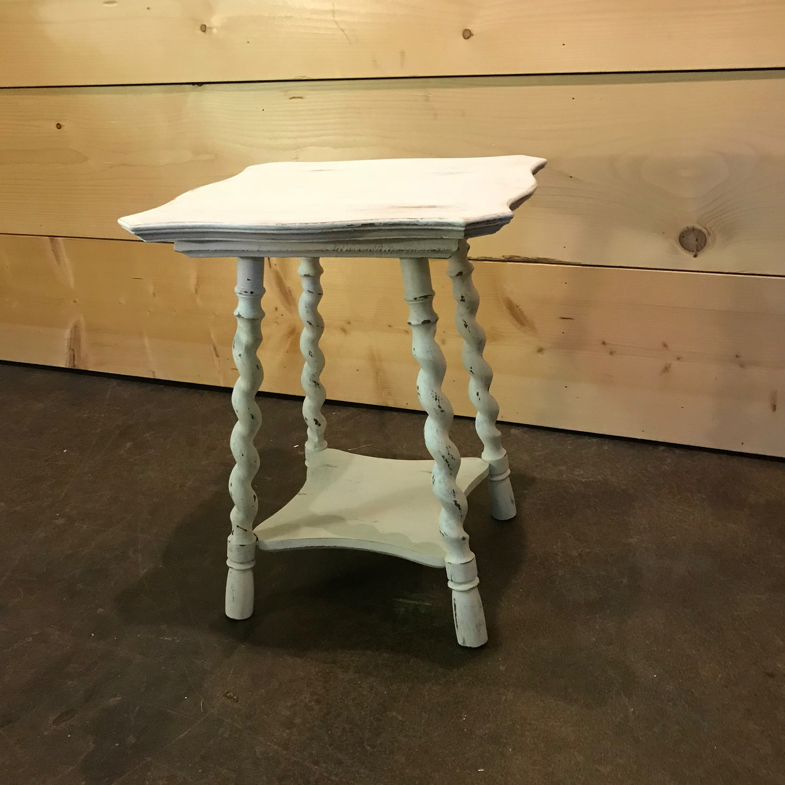 """Barnabas   Petite white chalk painted, distressed side table. Barclay twist legs with a sculpted top and bottom shelf. 19.5"""" tall x 16"""" square."""