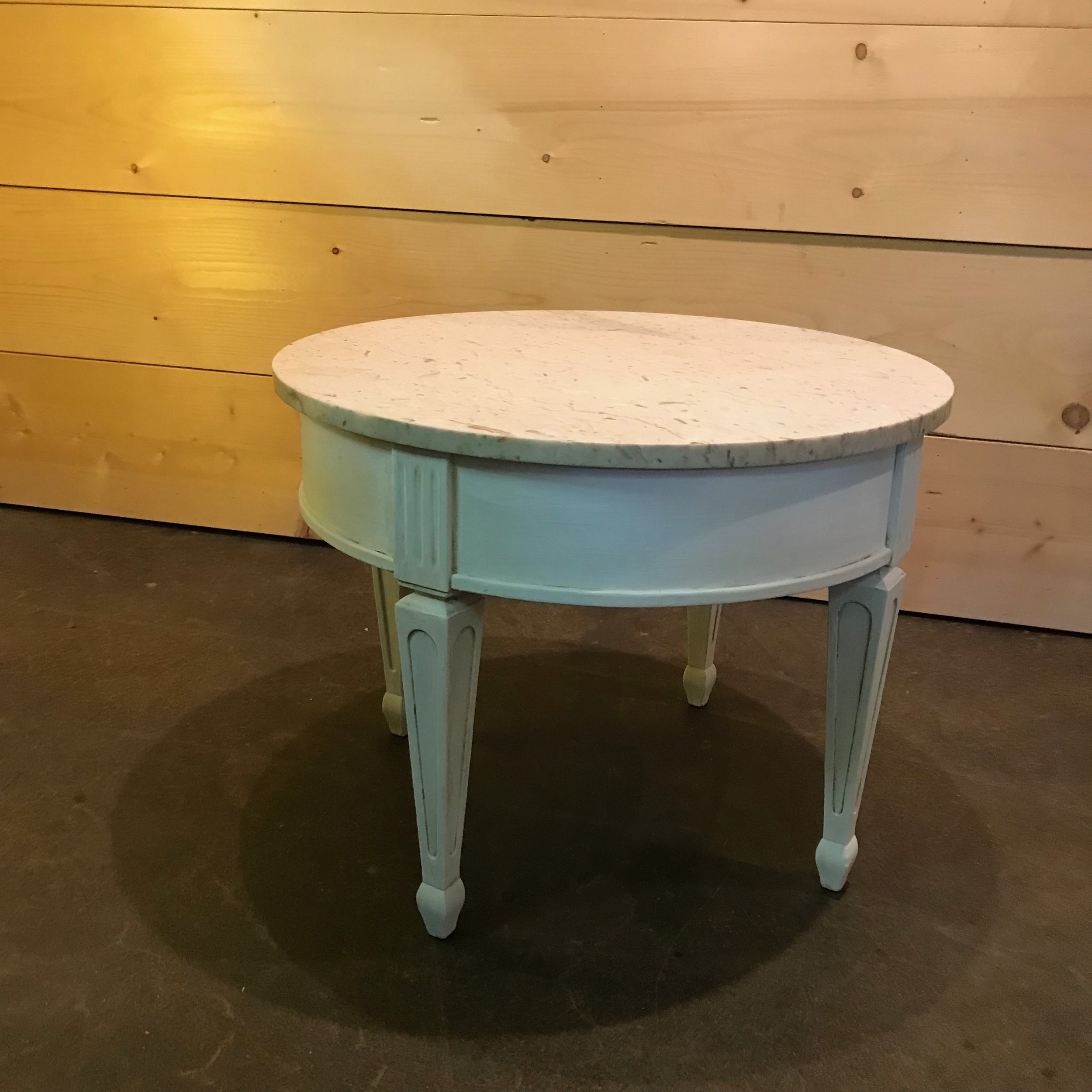 """Tasha   Mid-Century Modern round side tables painted in chalk white. Tan colored marble top. Detailed spindle legs. 20"""" tall x 26"""" round. We have two of these beauties."""