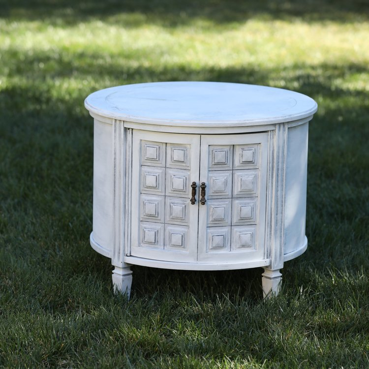 """Bertie   Mid Century Modern, white with grey undertones, one door that opens. Detailed doors with square pattern. 25"""" round by 22"""" high."""