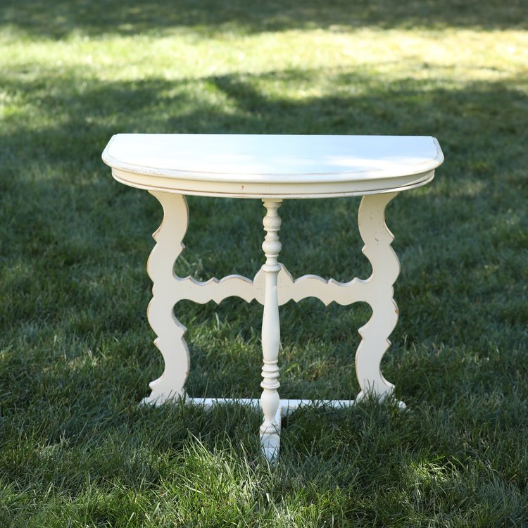 """Emma   Wooden, white, half round, sculpted detailed table. 30""""x18"""" top by 27"""" high."""