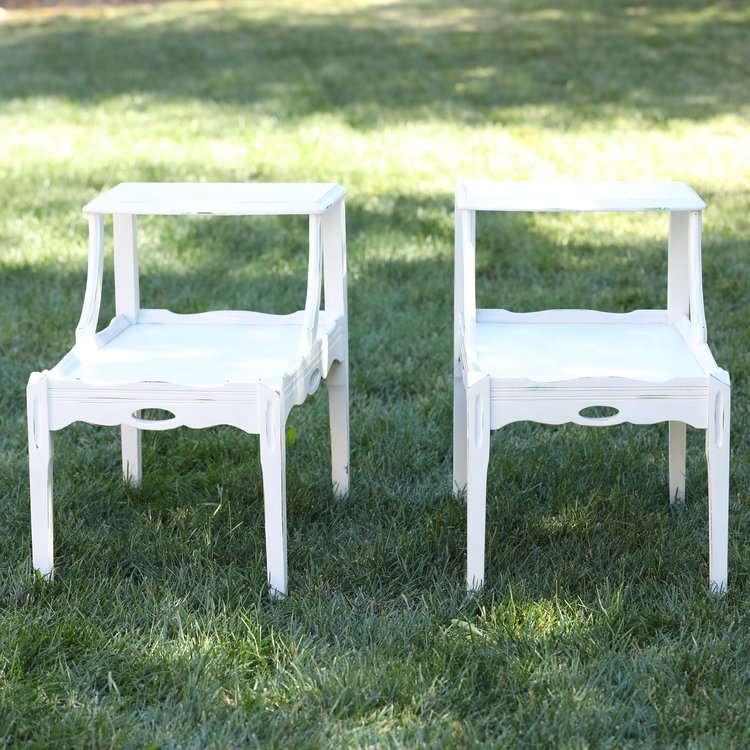 """The Lindsey Twins   White double tiered accent/end tables. Bottom rectangle 26""""x16"""", top shelf 16.5"""" x 11"""", 24"""" high. Rents as a pair."""