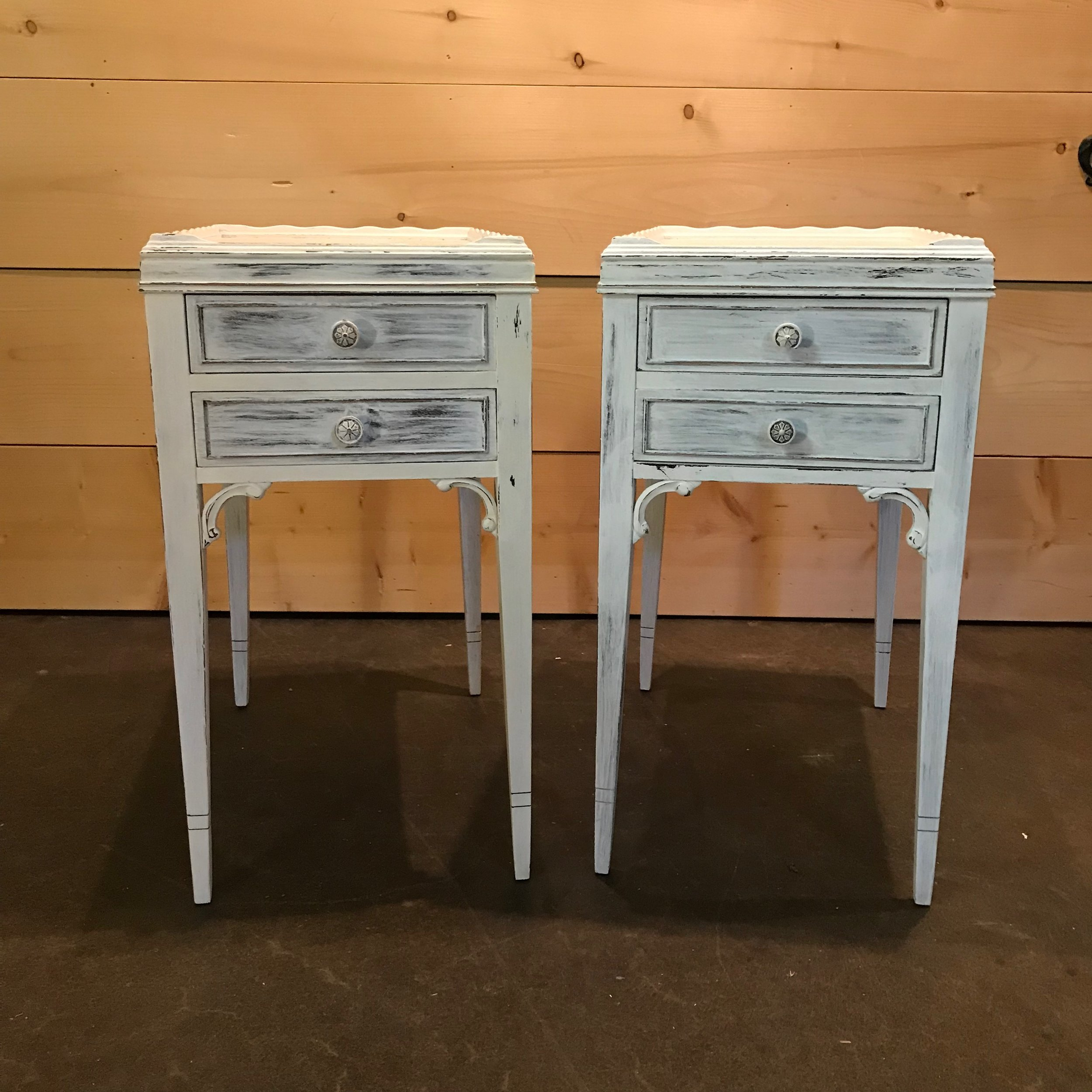 """Mick and Keith   Two chalk painted white tables. Scalloped top with two drawers. 26"""" tall x 11"""" wide x 14"""" deep"""