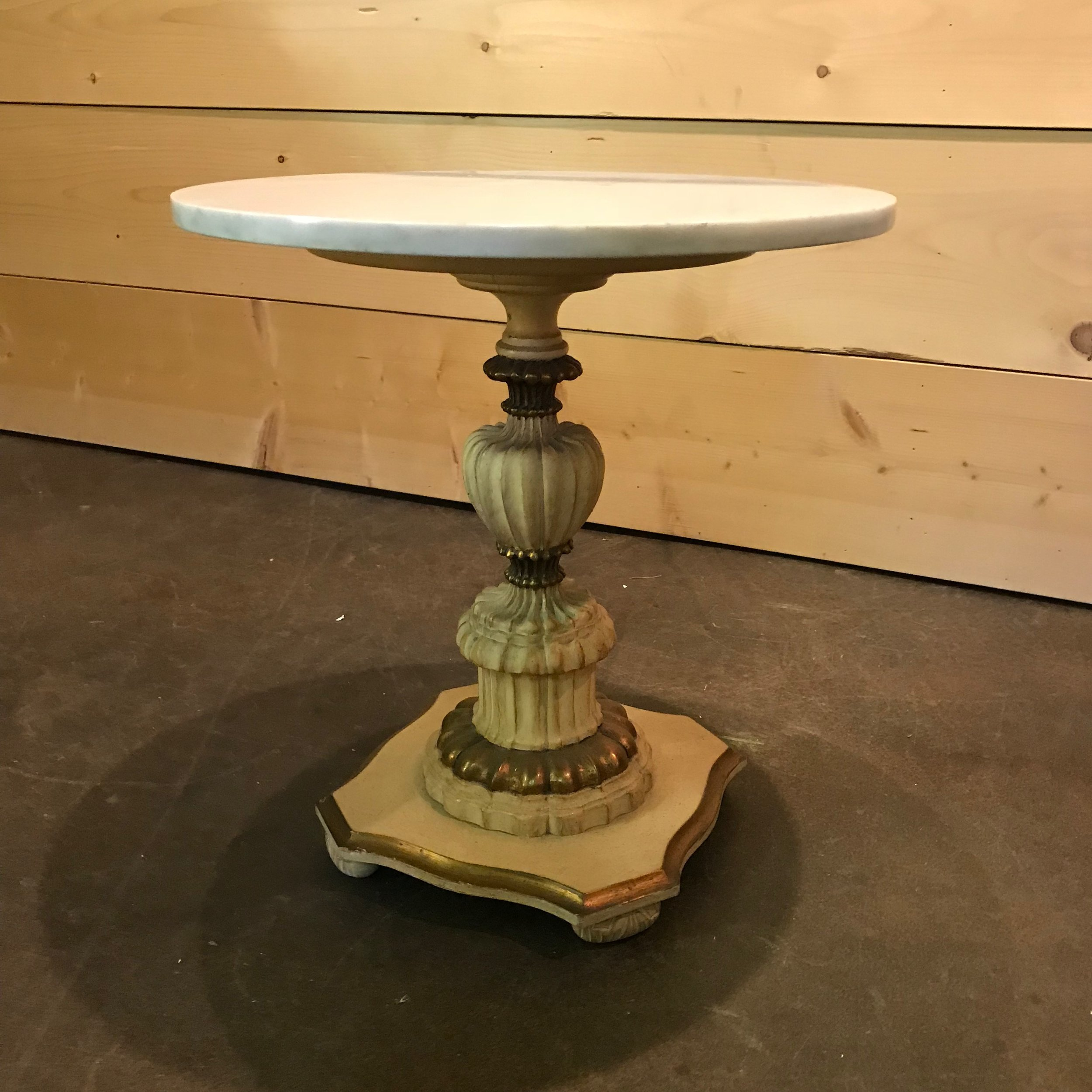 """Lulu   Hollywood Glam/ French side table. Tassel bottom with a marble top. Off white with gold accents, 21.5""""tall x 20"""" round."""