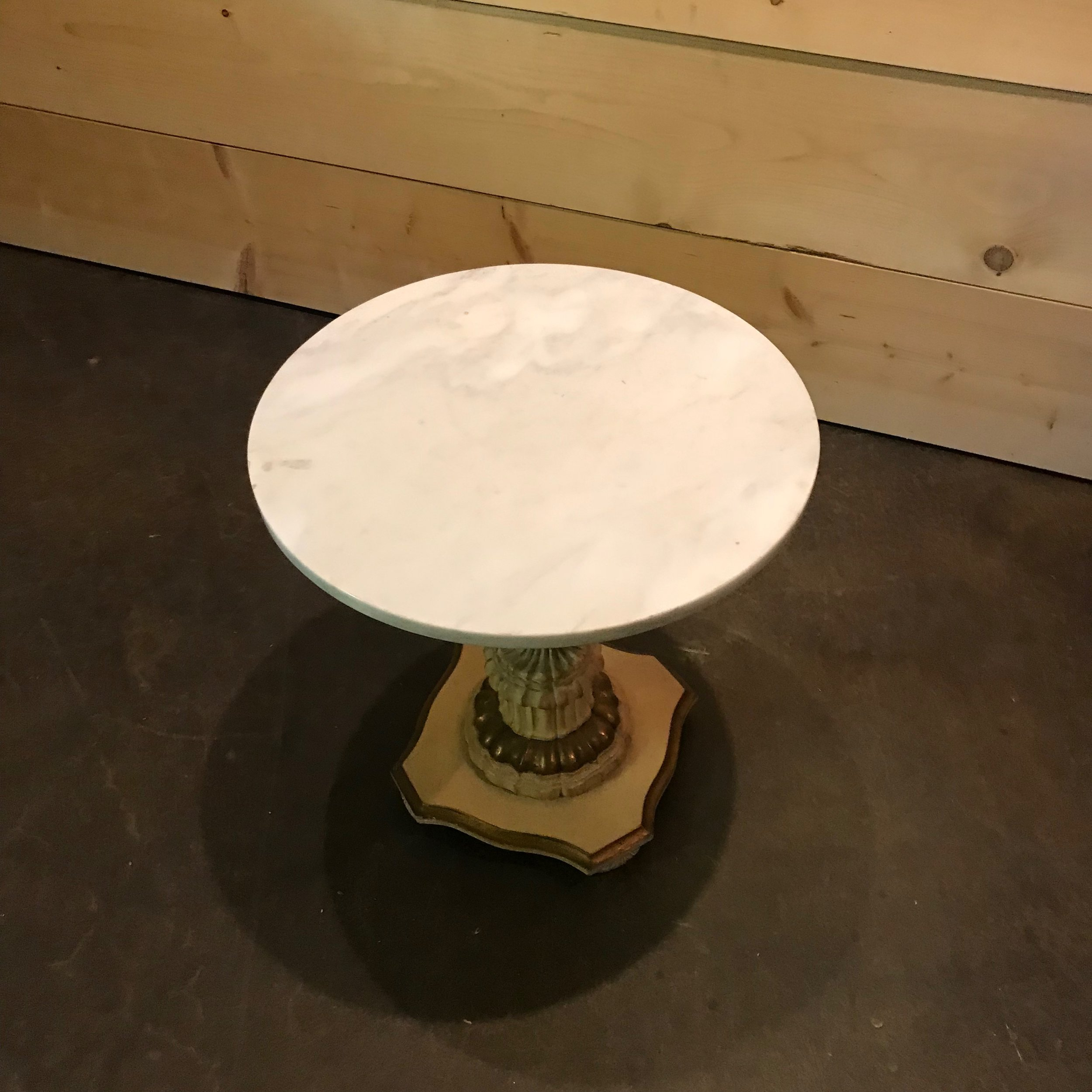 Hollywood Glam French side table. Off white with gold accents and a marble top.