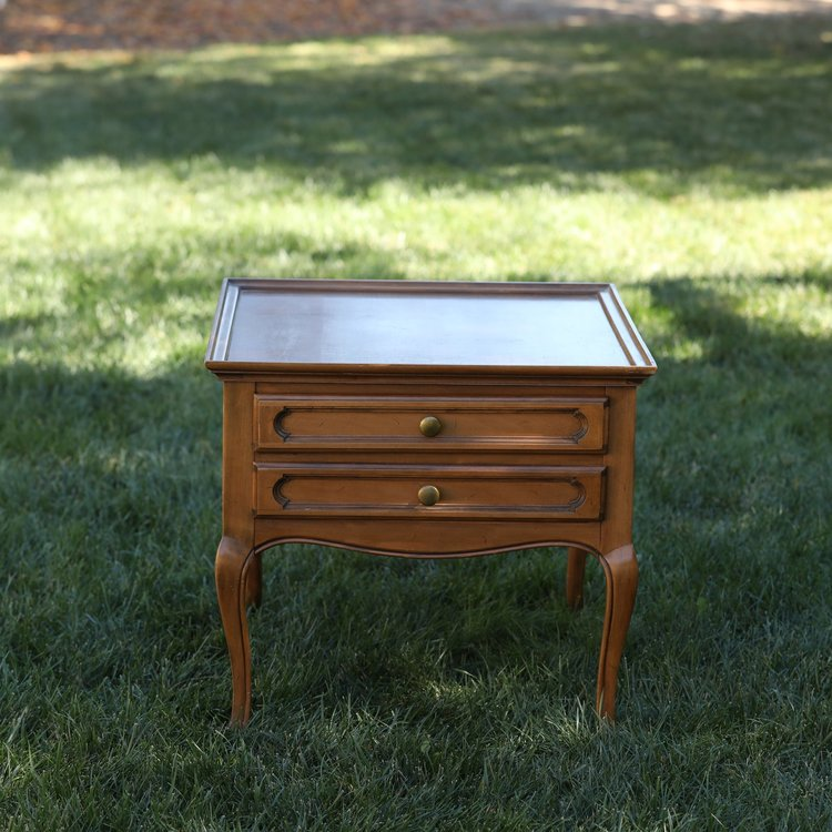 """Rita   Wooden, French country side table with really cute legs, two drawers. 28""""x24"""" rectangle by 23"""" high."""