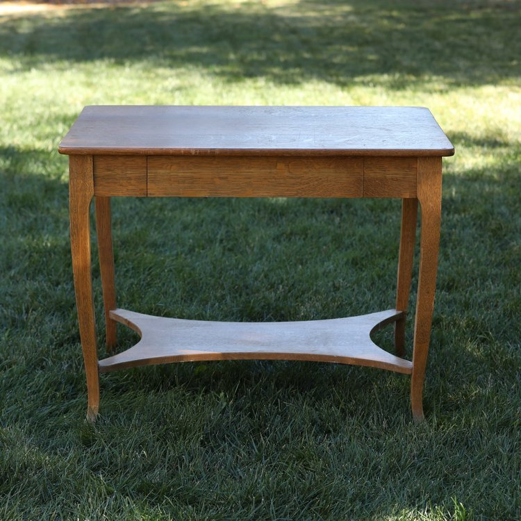 Phillip   Small rectangle couch table. Curved legs with a shelf at the bottom.