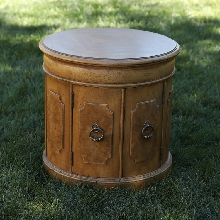 """Sebastian   Mid Century Modern, barrel side table, two opening doors. 25"""" round by 24"""" high."""