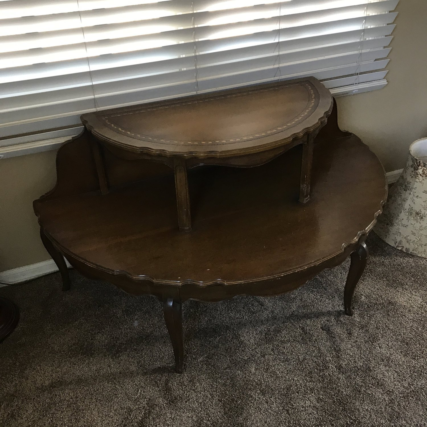 """Penny   Two tiered, half round, side table. Leather top with gold leaf. Bottom shelf 48"""" x 24"""". Top shelf 32"""" x 16.5"""". 25"""" high."""