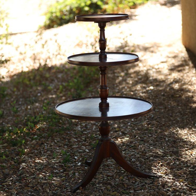 """Claudia   Three tiered, circa 1940, piecrust table with metal claw feet. Bottom tier 22"""" round, middle tier 16"""" round, top tier 12"""" round."""