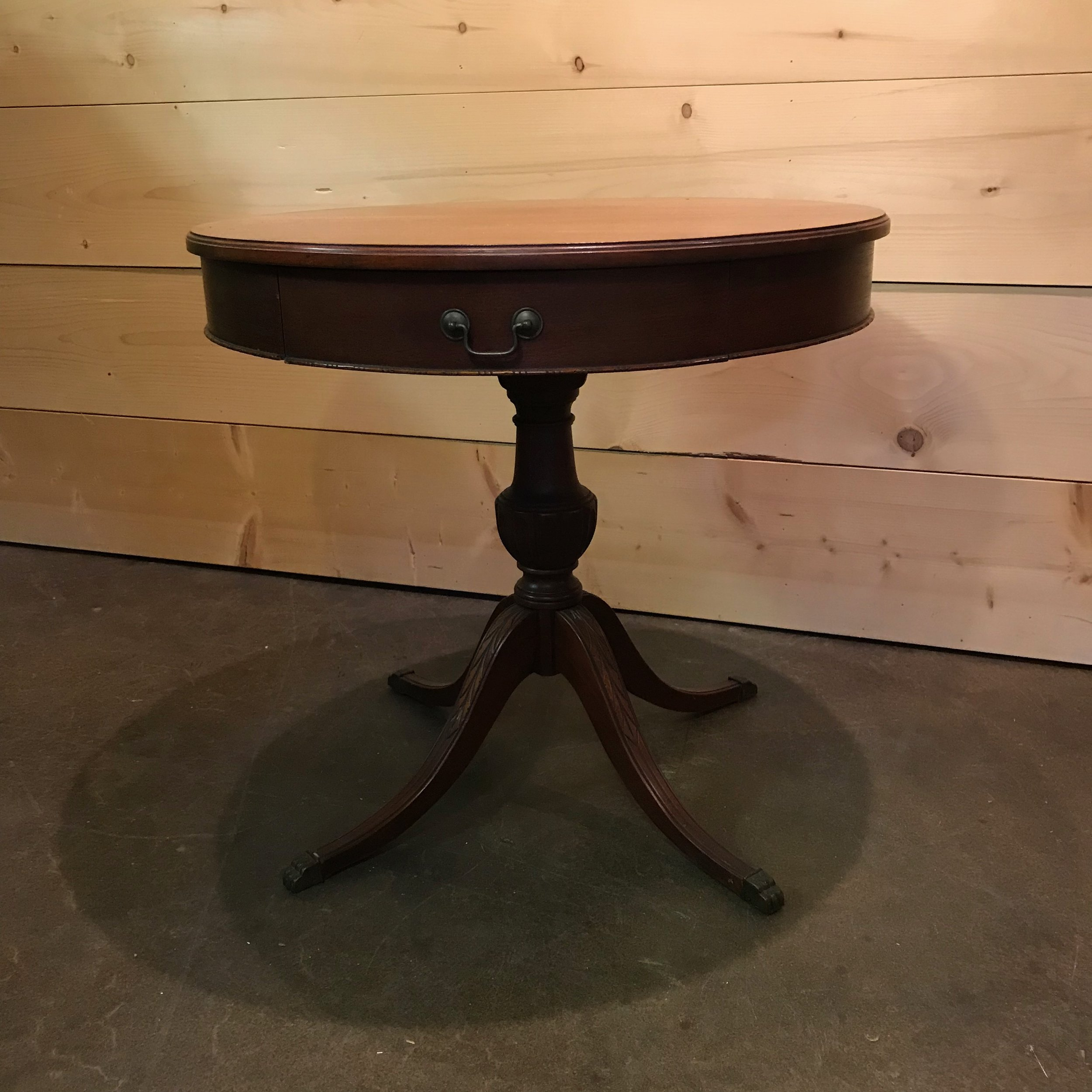 """Jerry   Round side table with center spindle and four legs with a center drawer. 28"""" tall x 30"""" round."""
