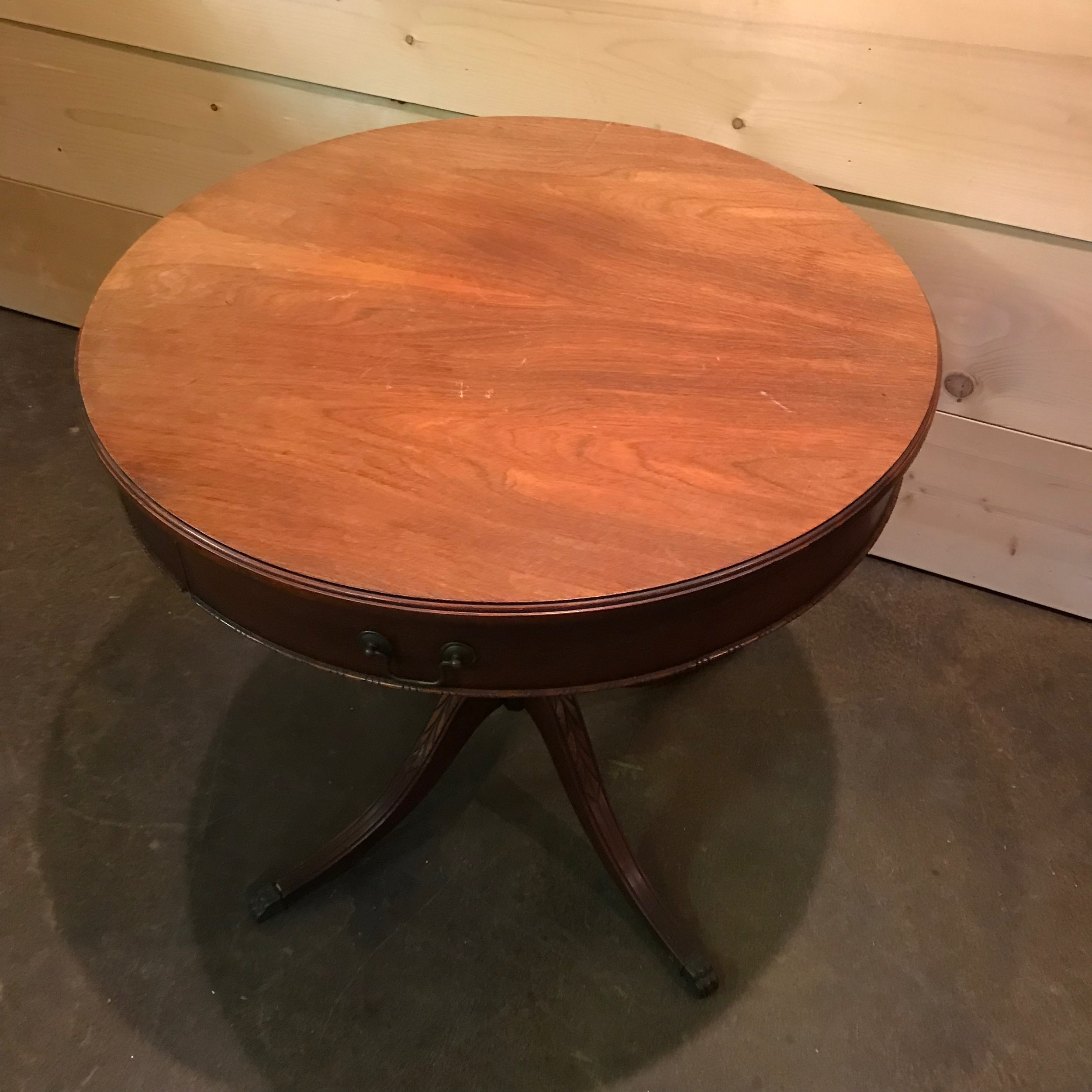 Vintage Mid Century Modern round side table with one drawer.