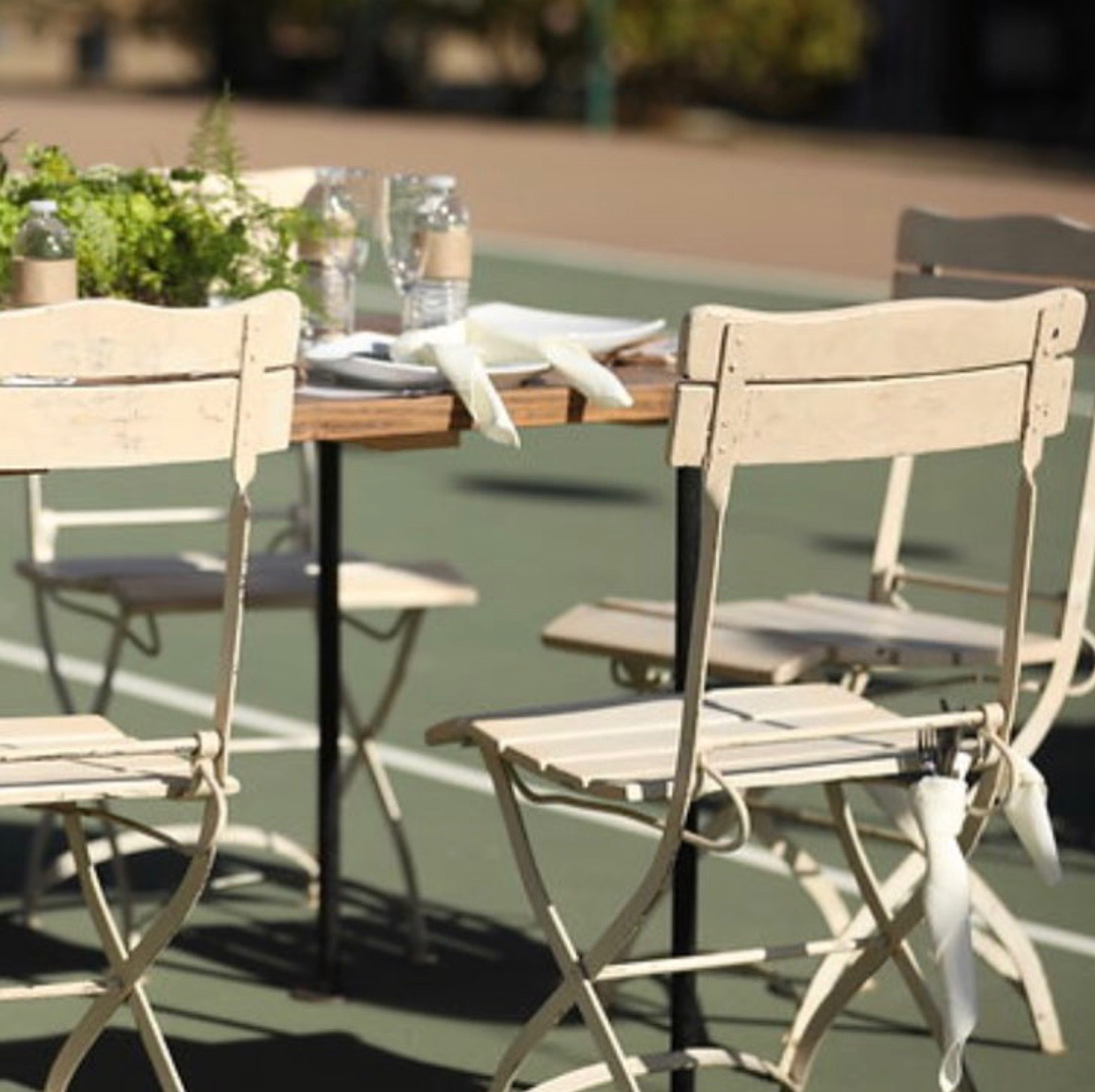 Cream Bistro Chair   Metal frame with a cream painted wood seat and back. Very comfortable and sturdy.