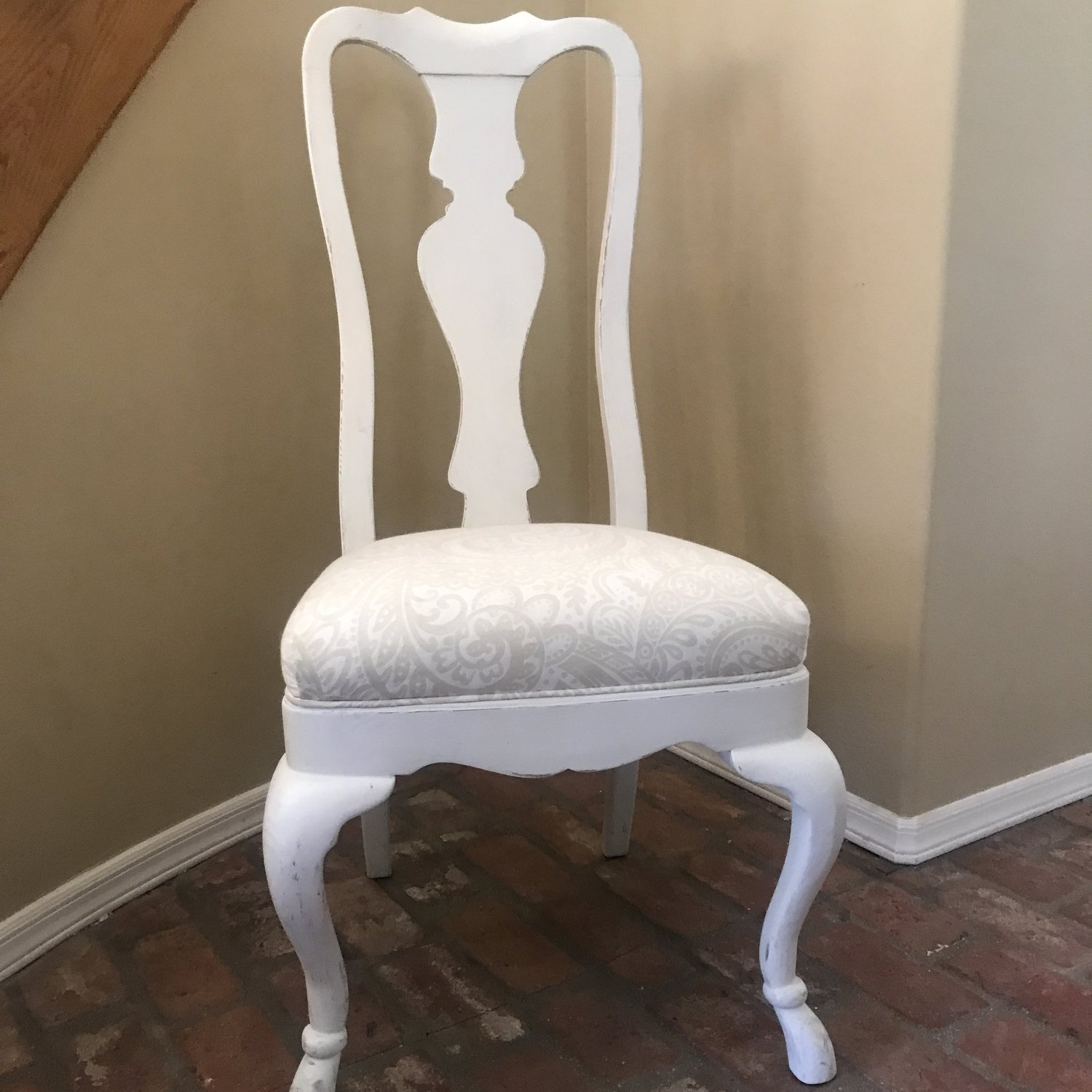 Great for that shabby chic dining table, this white wooden padded chair with curved legs is sturdy and available to rent.