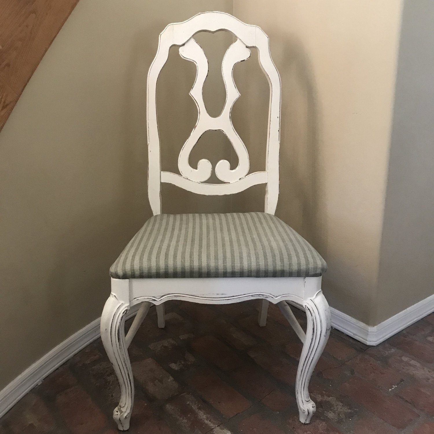 "Gentry   Shabby Chic white chair with scroll decorative back, resting on French Provincial legs. Sage green striped cushion. Pairs well with Brittney and Logan. Seat 21""x17"" Height 42"""