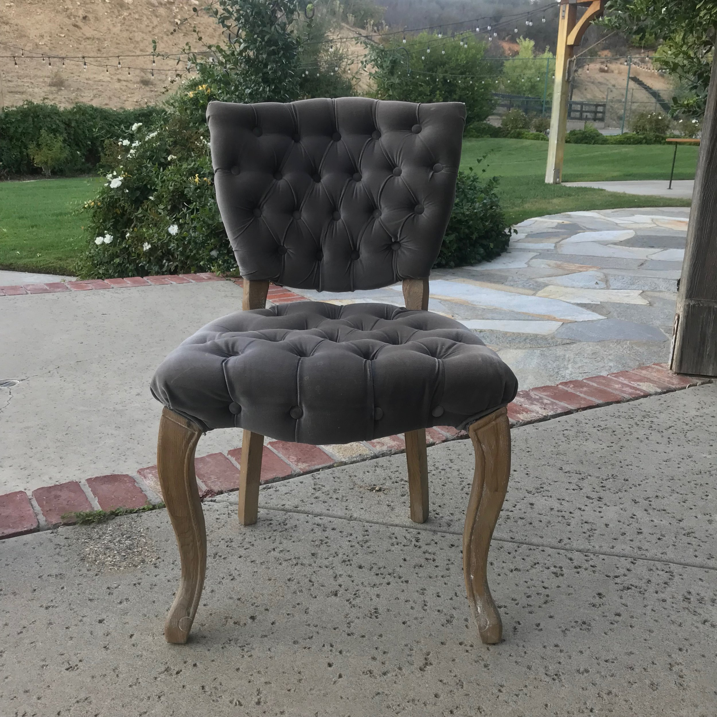 "Valarie   Grey velvet tufted back chair with French limed oak legs. Great addition to a head table. Seat 21"" x 18"". 32"" tall. There are four of these chairs available."