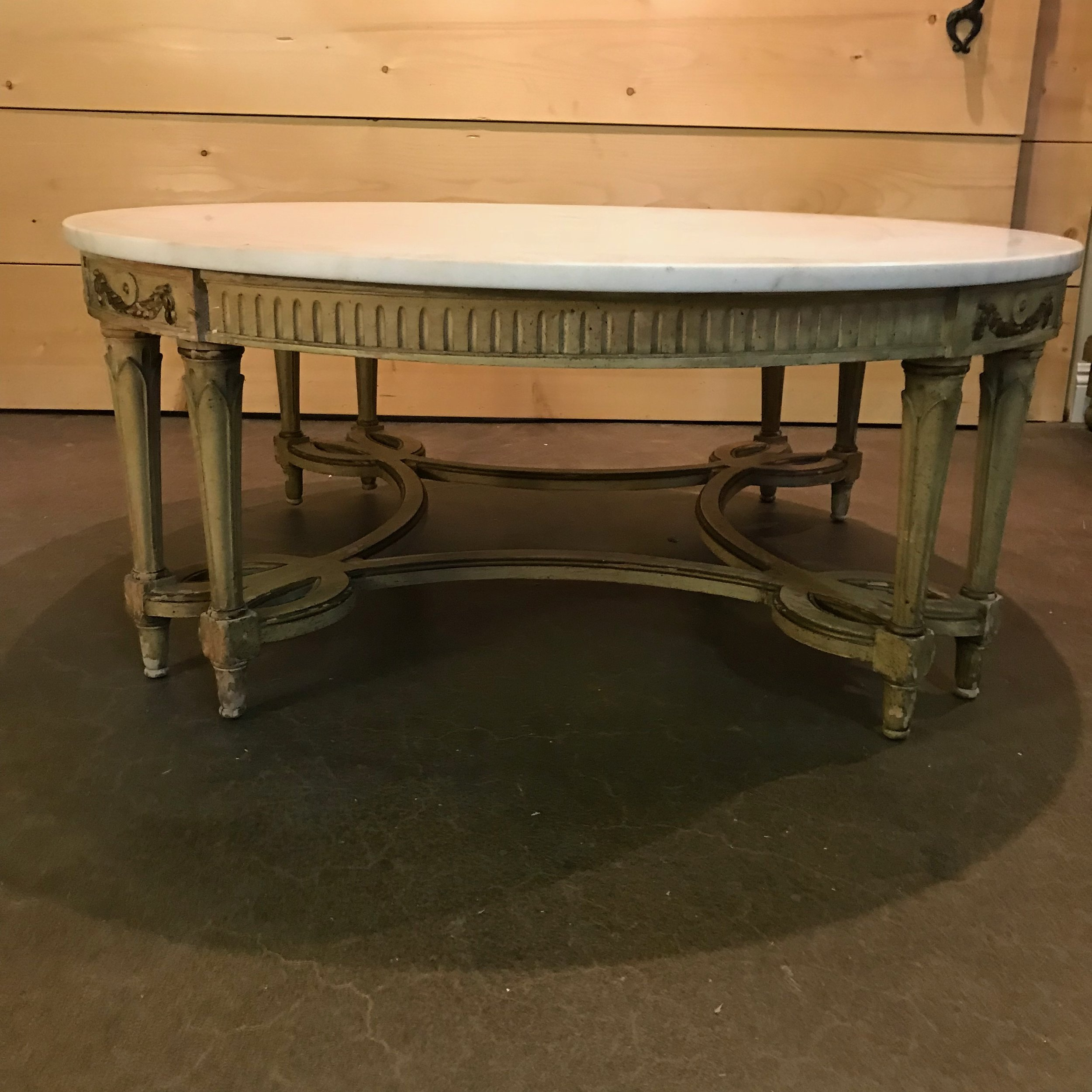"Greta   Round Hollywood Glam coffee table. Double legged with a marble top and gold accents. 49"" round x 17"" high"