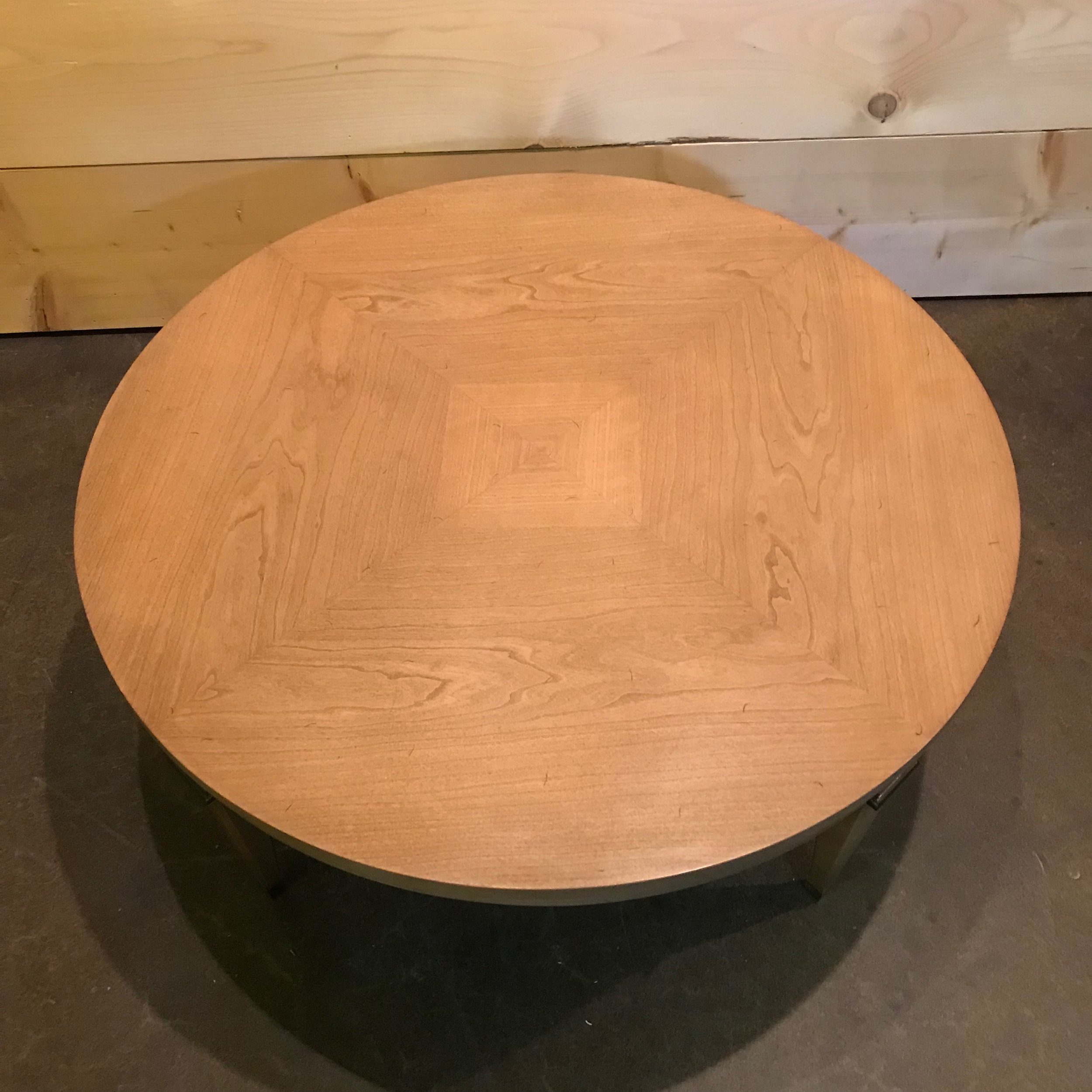 Light wood round Mid Century Modern coffee table for rent.