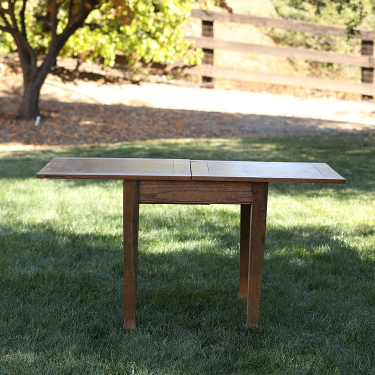 Betsy   Oak tri-fold table that can be square or rectangle. The perfect little size.