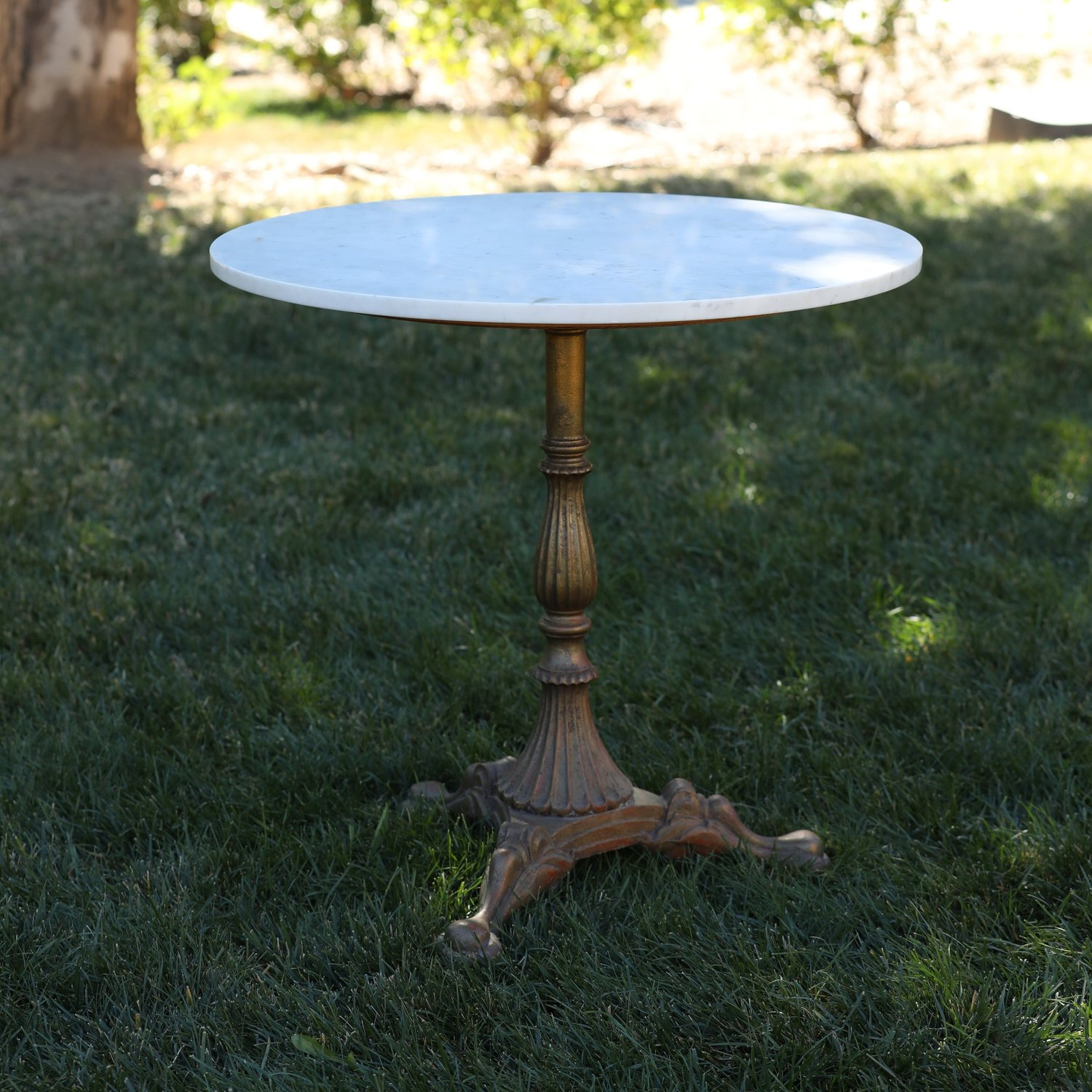 """Grace   Marble topped table with a brass base. Perfect for a cake table or sweetheart table. Two sizes of marble available, larger size at an additional charge. Round 29"""" tall."""