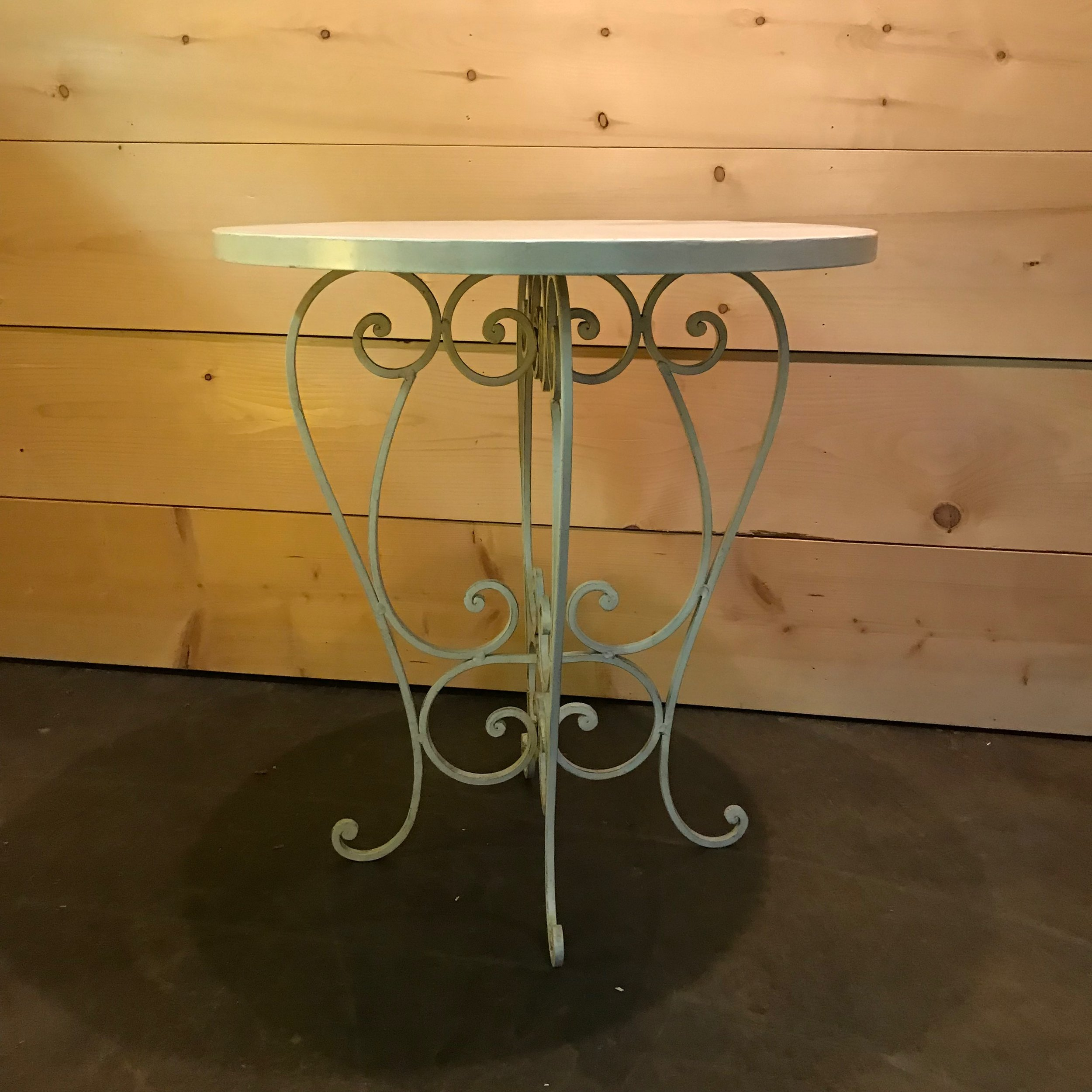 """Justin   Round white metal table with elaborate scrolled legs. Perfect to showcase your wedding cake or to use as a sweetheart table. 30"""" tall x 28"""" round"""