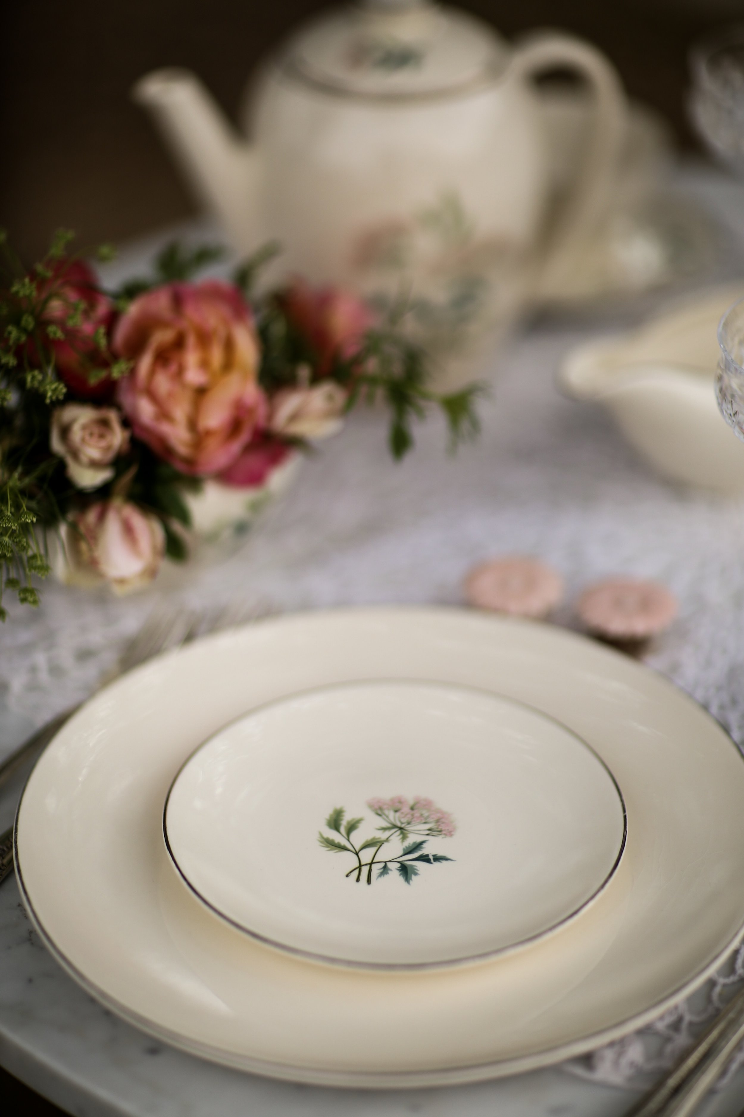 Ming Pattern of Homer Laughlin vintage china has a delicate pink flower with green stems. For rent.