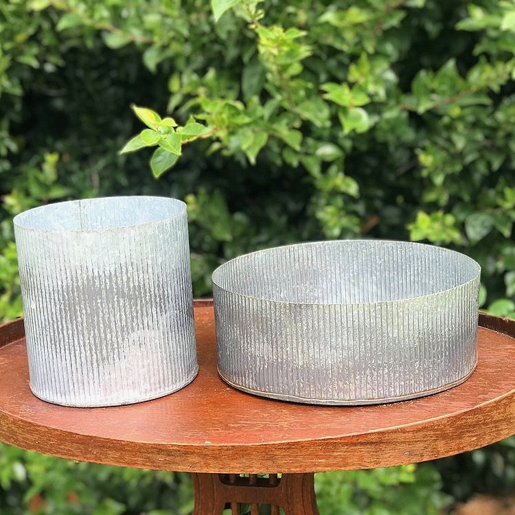 Galvanized Floral Containers   Round corrugated galvanized containers great for floral centerpieces.