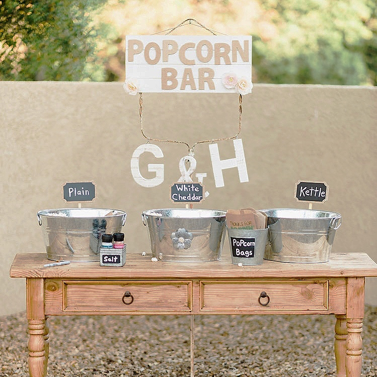 Galvanized tubs filled with popcorn at a popcorn bar at a wedding in Murrieta.