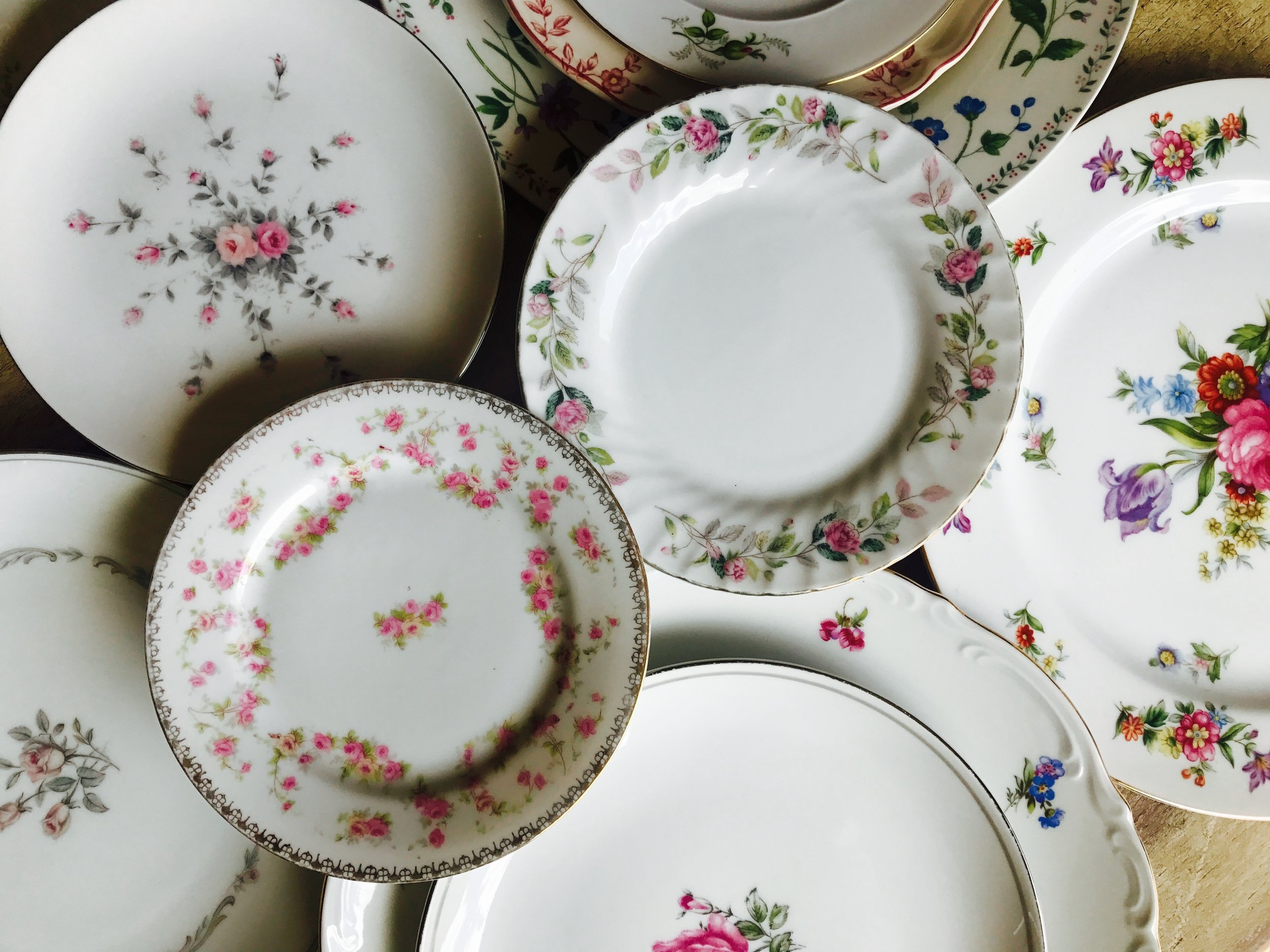 Mismatched floral pattern vintage china dinner, salad, and bread plates located in the Temecula Valley.