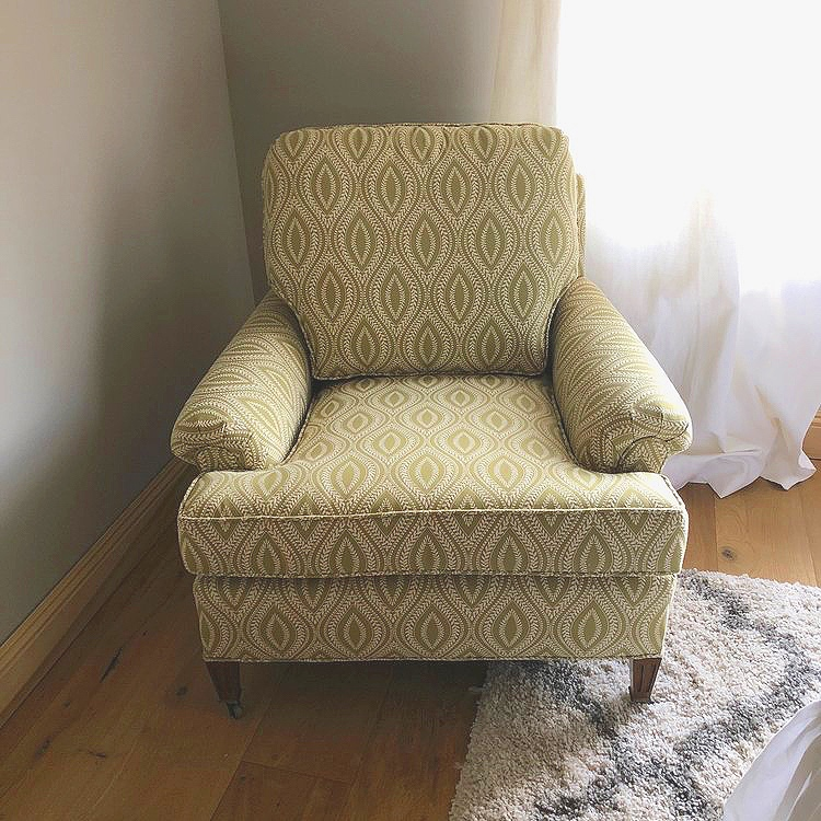 """Margo  Green and cream Mid-century modern laurel print with tapered legs. Loose back with T cushion seat. 31"""" tall x 37"""" wide."""