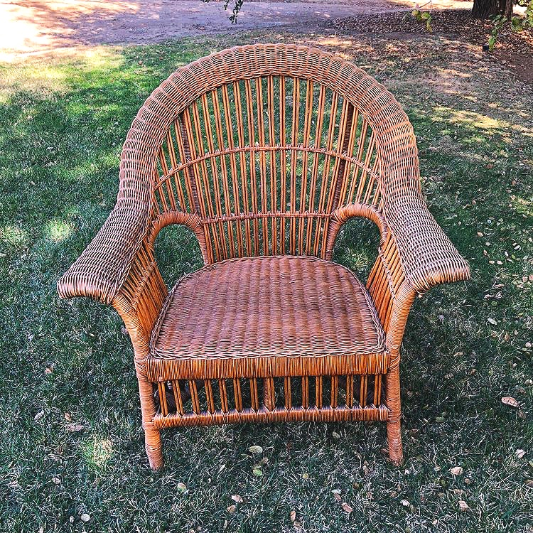 """Lilly  Brown wicker chairs, 36""""wide x 37"""" high x 22"""" deep. Seat 16"""" high. We have two of these chairs. They are also matching with a couch."""
