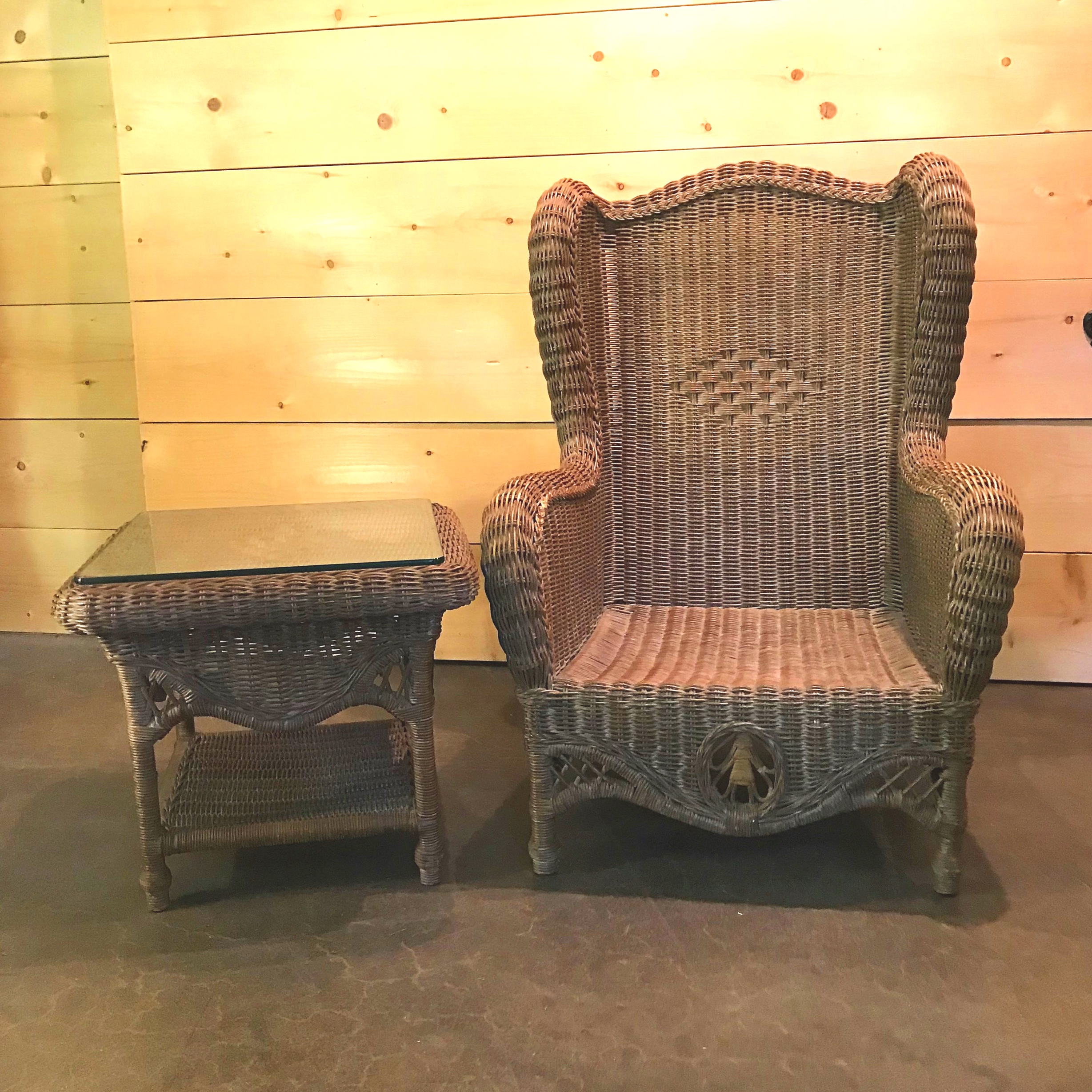 """Sandra  Brown tightly weaved wicker chair set and a wicker side table with a glass top. The two chairs measure 44"""" high x 31"""" wide x 21"""" deep. Table 20"""" high x 23"""" square"""