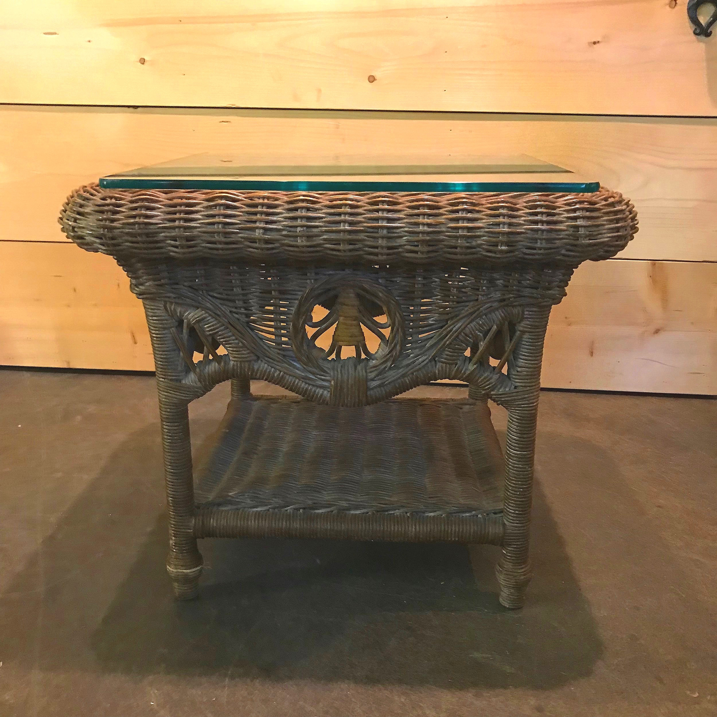 Brown wicker side table with a glass top