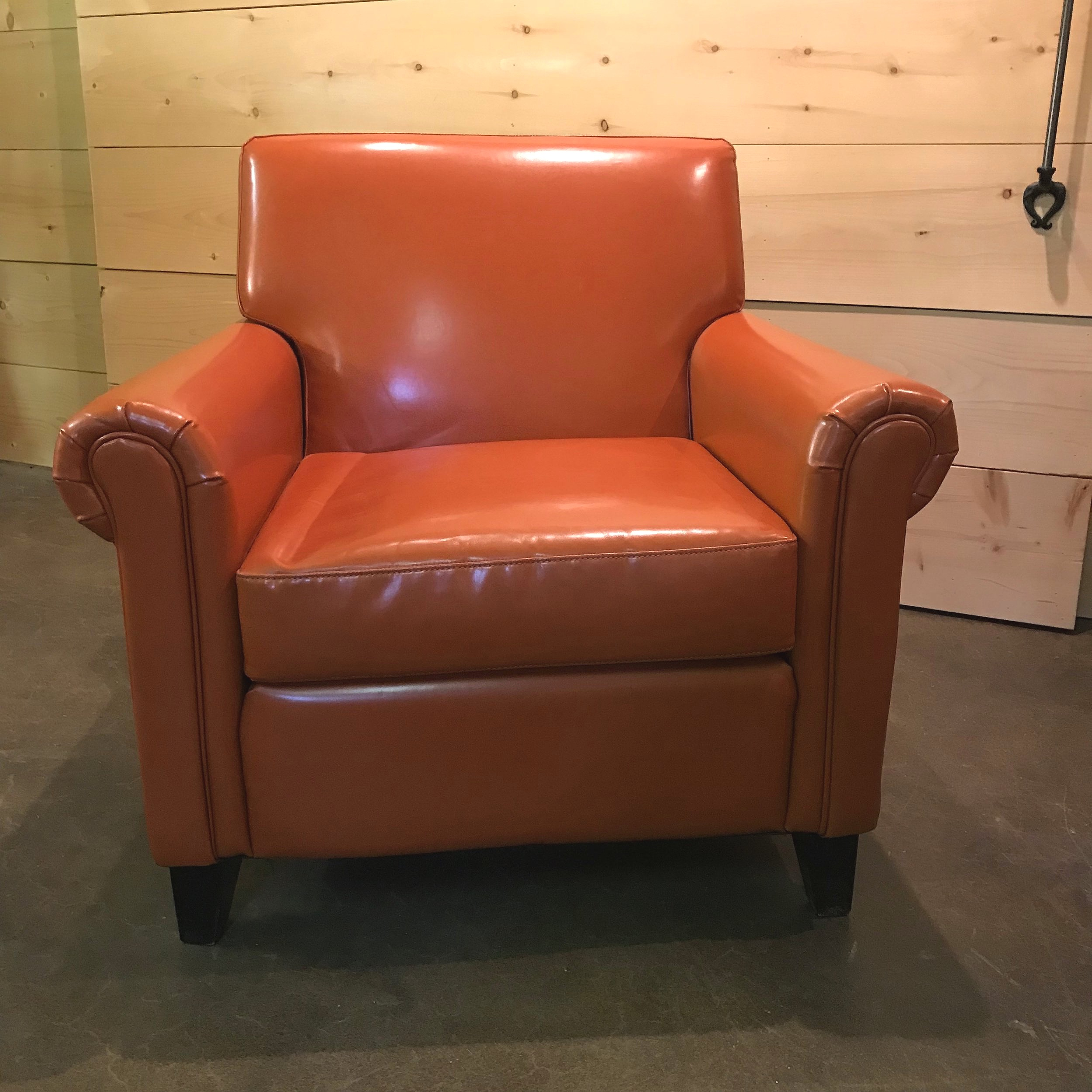 """Lyle  Orange letter stuffed chair with rounded arms. 22"""" deep x 34"""" high x 35"""" wide."""
