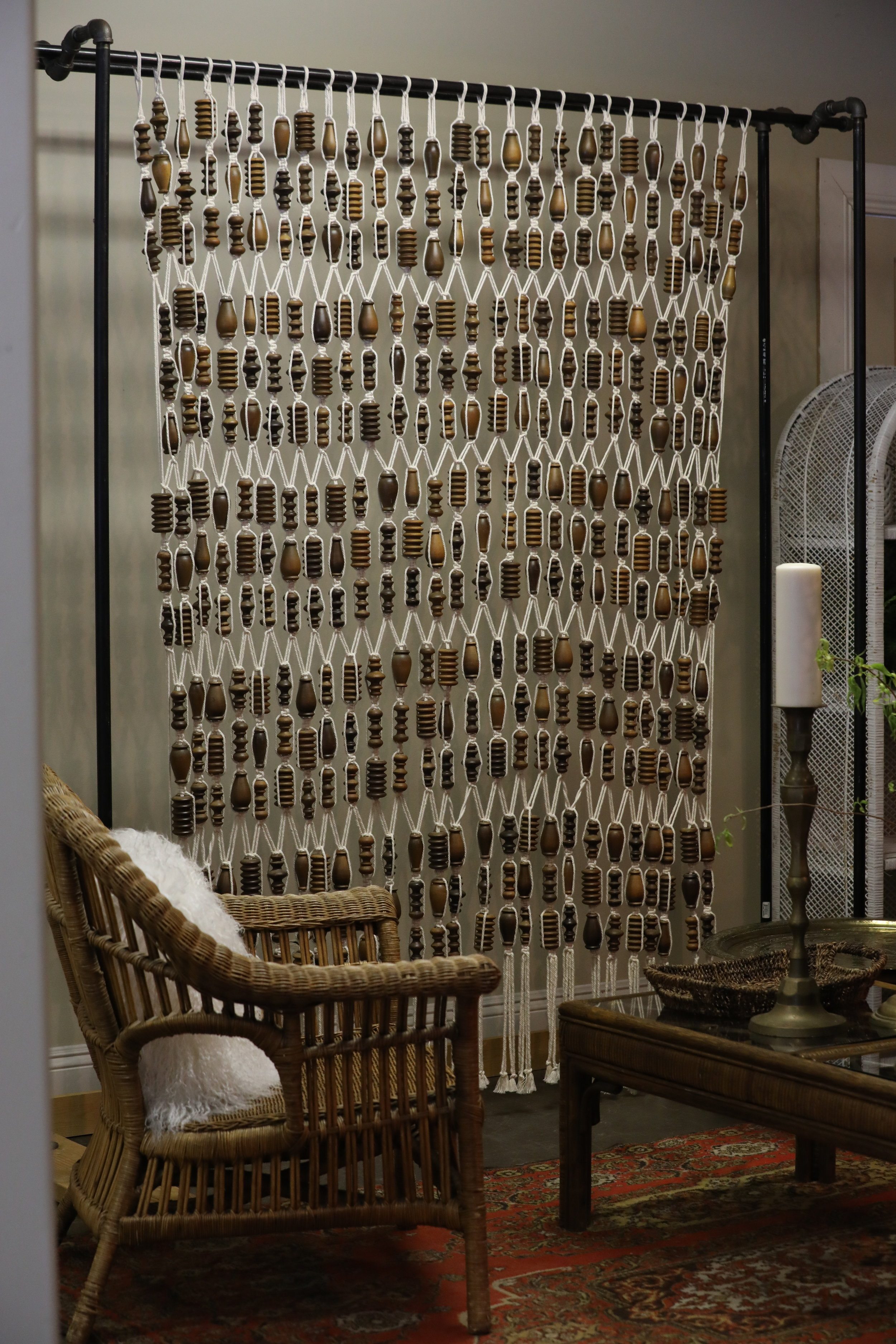 Ziggy   Macrame beaded backdrop hanging from our free standing pipe holders. Available in 3 heights.