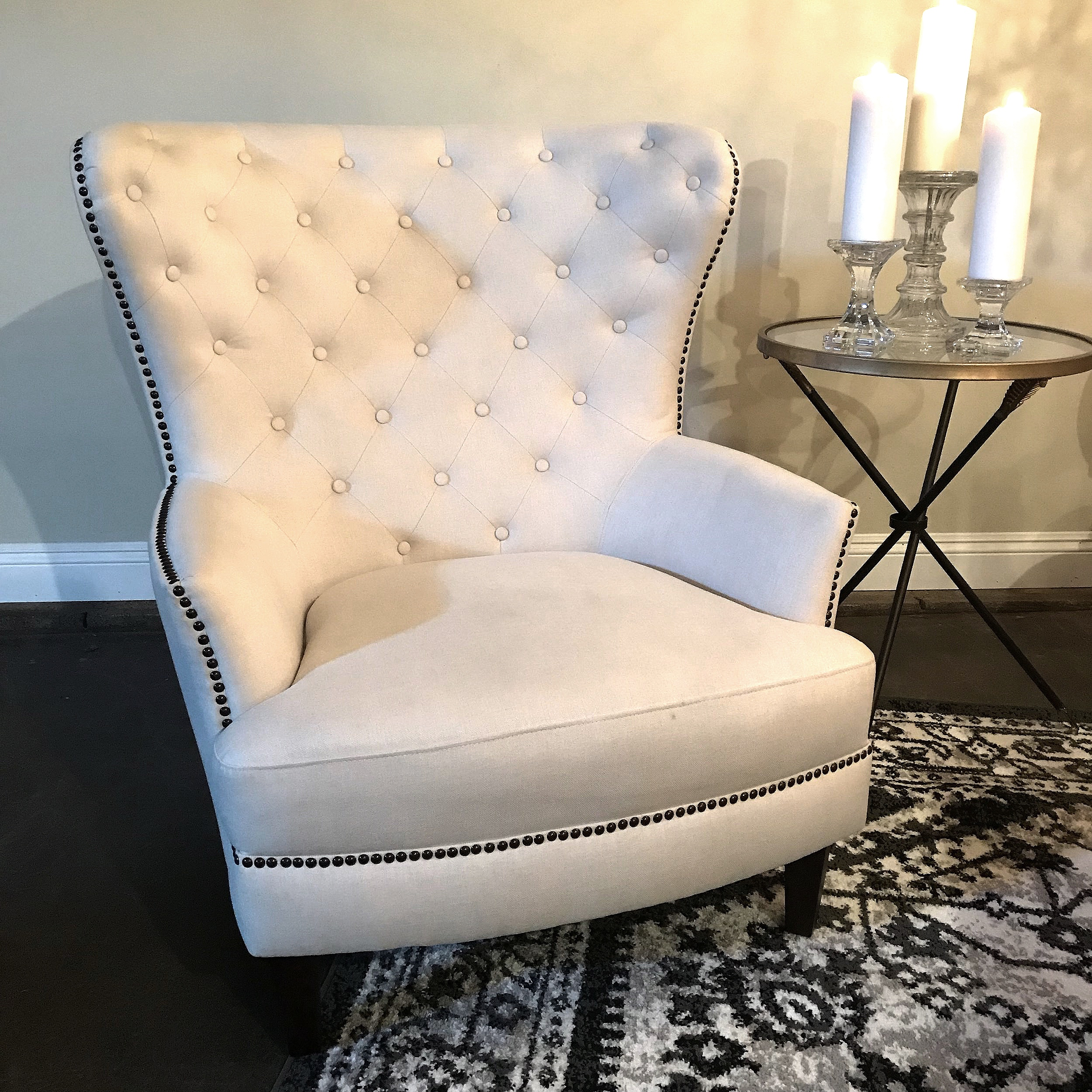 Logan  Cream linen, tufted wing back chair with nail head trim. Great for a lounge area.